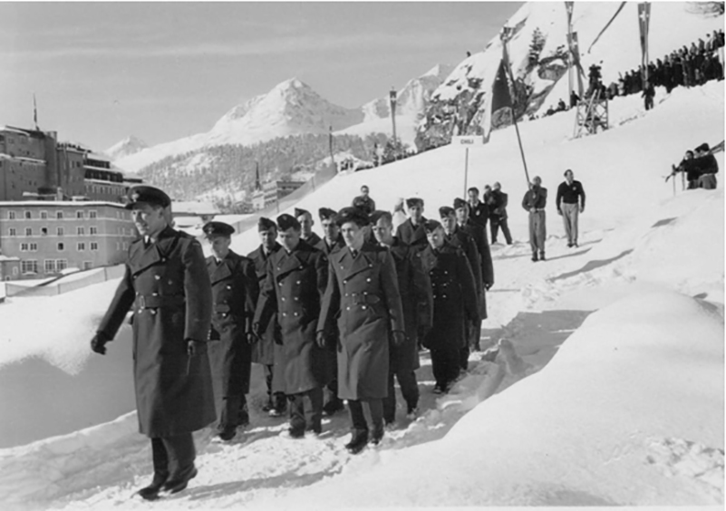 With Squadron Leader Sandy Watson out in front, the RCAF Flyers march to the Stad Olympique for the opening ceremonies of the 1948 Winter Games in St. Moritz, Switzerland. PHOTO: Hubert Brooks private collection*