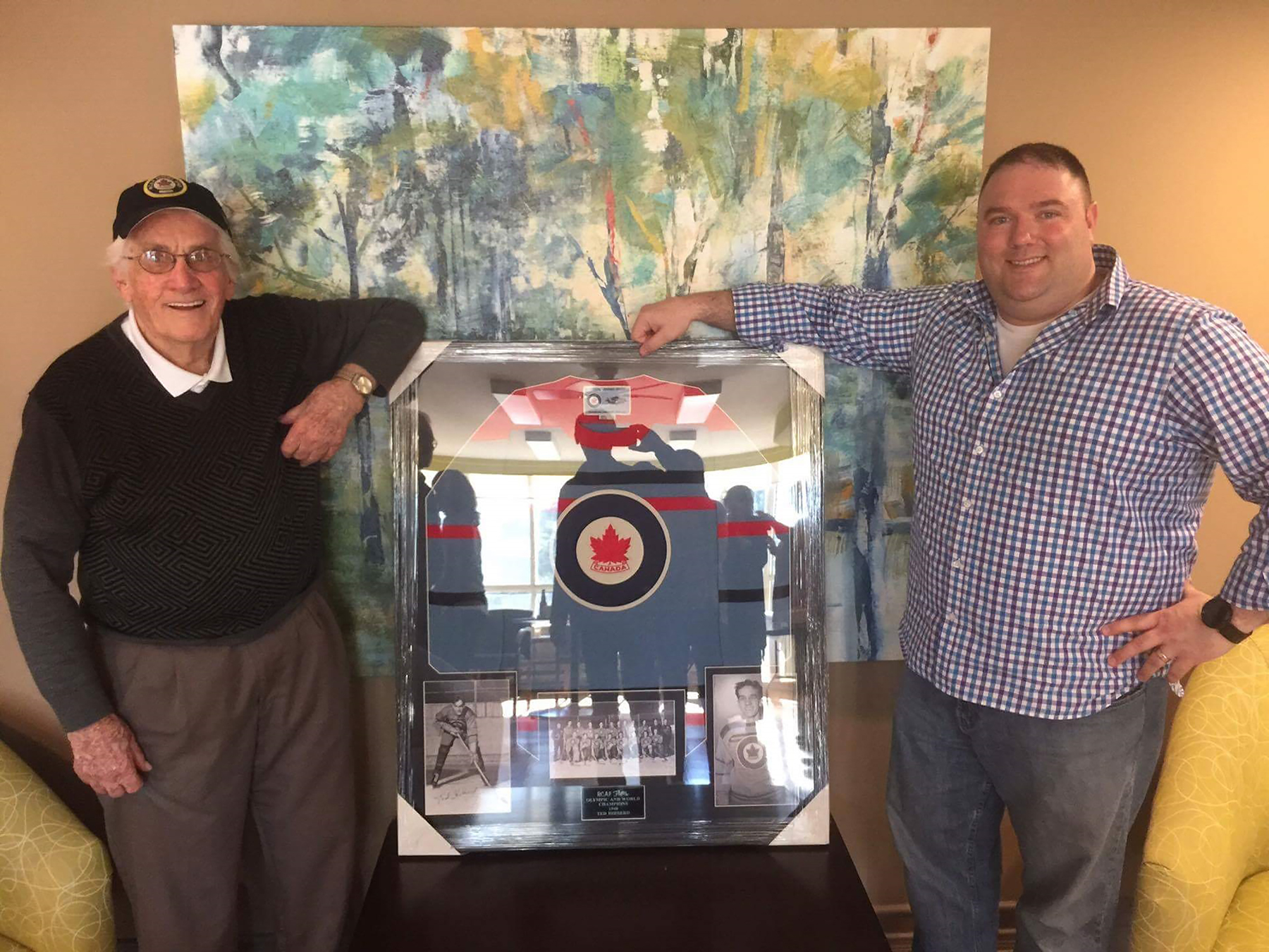 On April 22, 2016, Tim Schofield (right), Ted Hibberd's grandson-in-law, presented Mr. Hibberd with a mounted vintage Flyers jersey for his 90th birthday. PHOTO: Courtesy of Tim Schofield