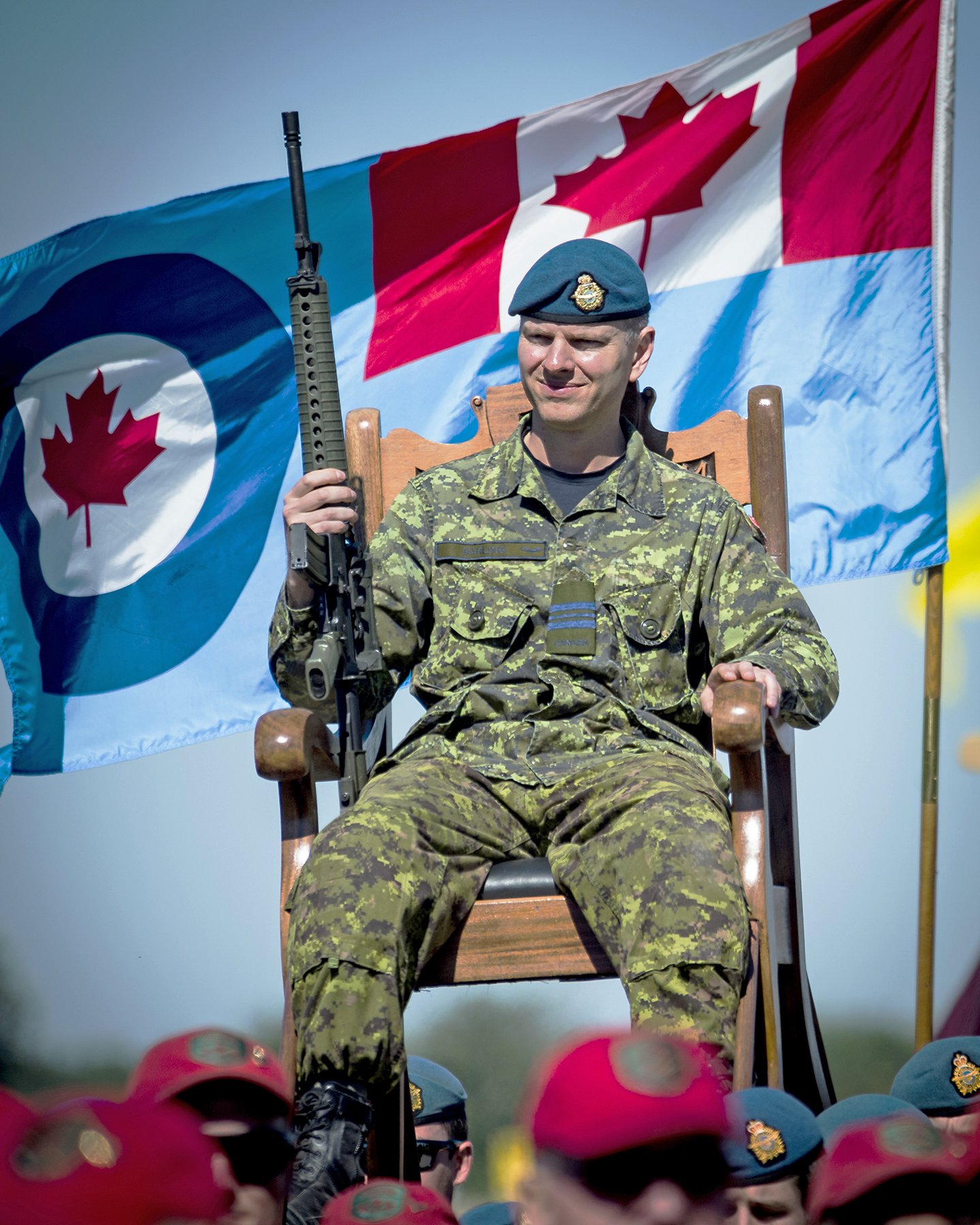Royal sedan chair - Chair On The Shoulders Of Other People An Rcaf Flag Waves Behind Him