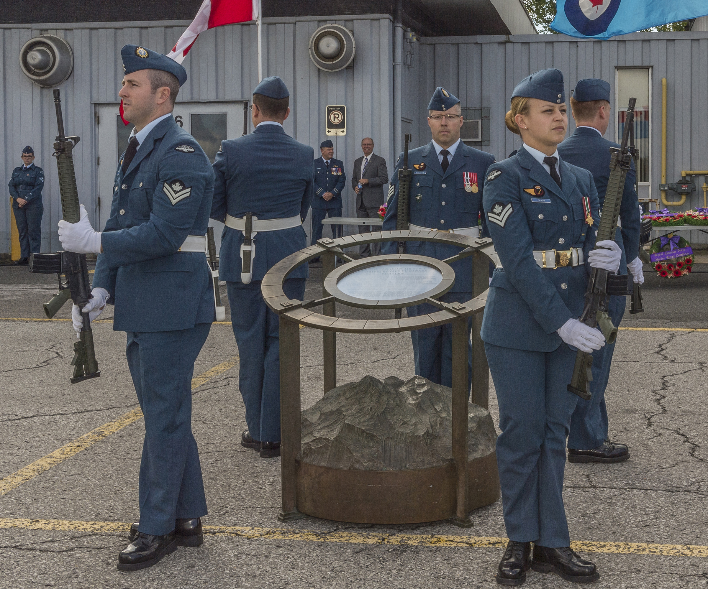 Members of the Royal Canadian Air Force present arms during their vigil at the RCAF cenotaph during the national Battle of Britain ceremony held Sunday, September 18, 2016, at the Canada Aviation and Space Museum in Ottawa. From left to right: Master Corporal Maxime Fournier, Master Corporal Donald Lickers, Sergeant Marc Ouellette, sentry commander, Master Corporal Louis Seguin, and Master Corporal Amanda Claus. PHOTO: Corporal Alana Morin, FA03-2016-0032-010