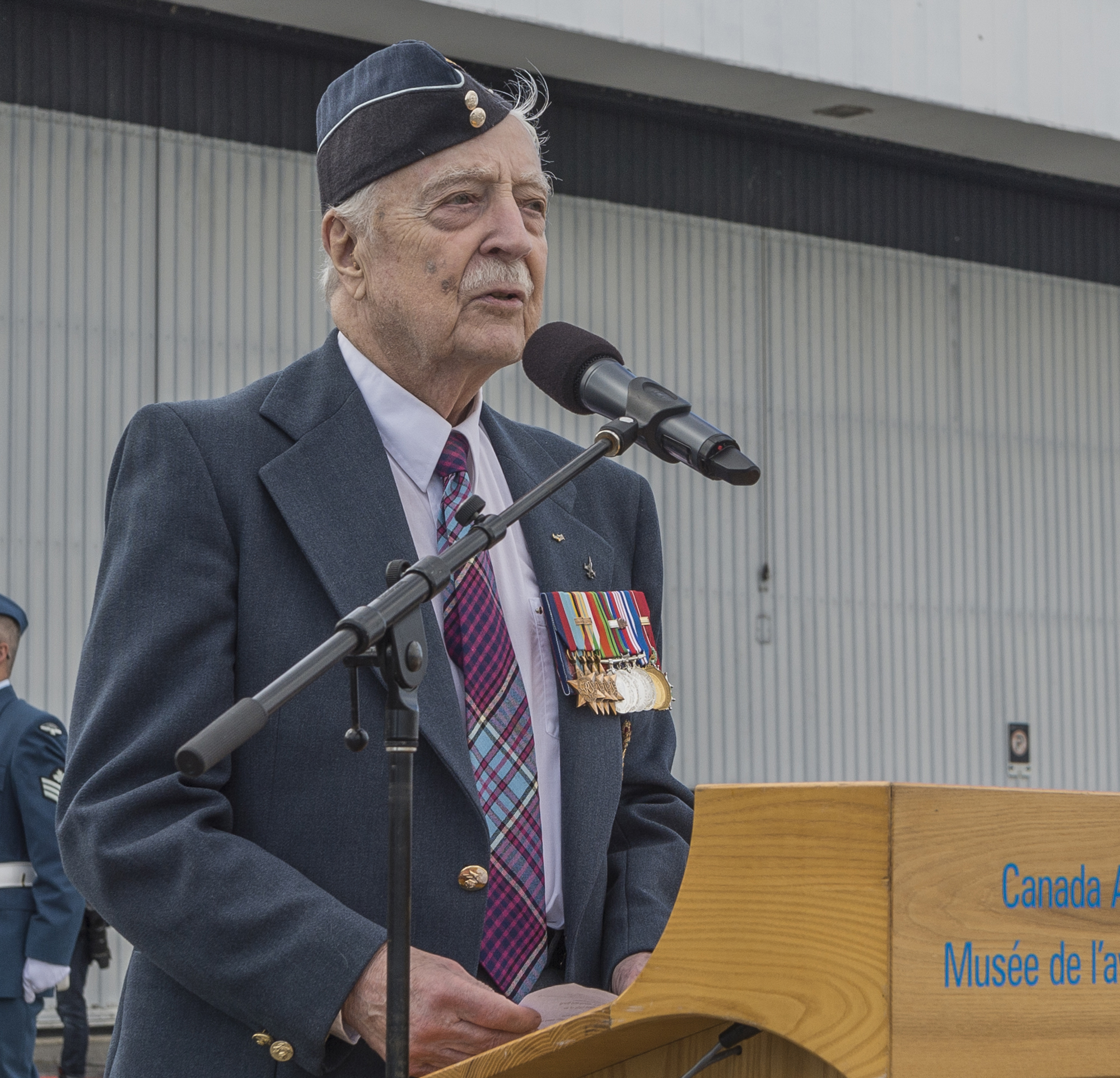 "Squadron Leader (retired) Lloyd Hunt, a veteran of the Second World War and the Korean War, read the airmen's poem, ""High Flight"" and the ""Act of Remembrance"" to the personnel on parade and the assembled spectators. PHOTO: Corporal Alana Morin, FA03-2016-0032-017"