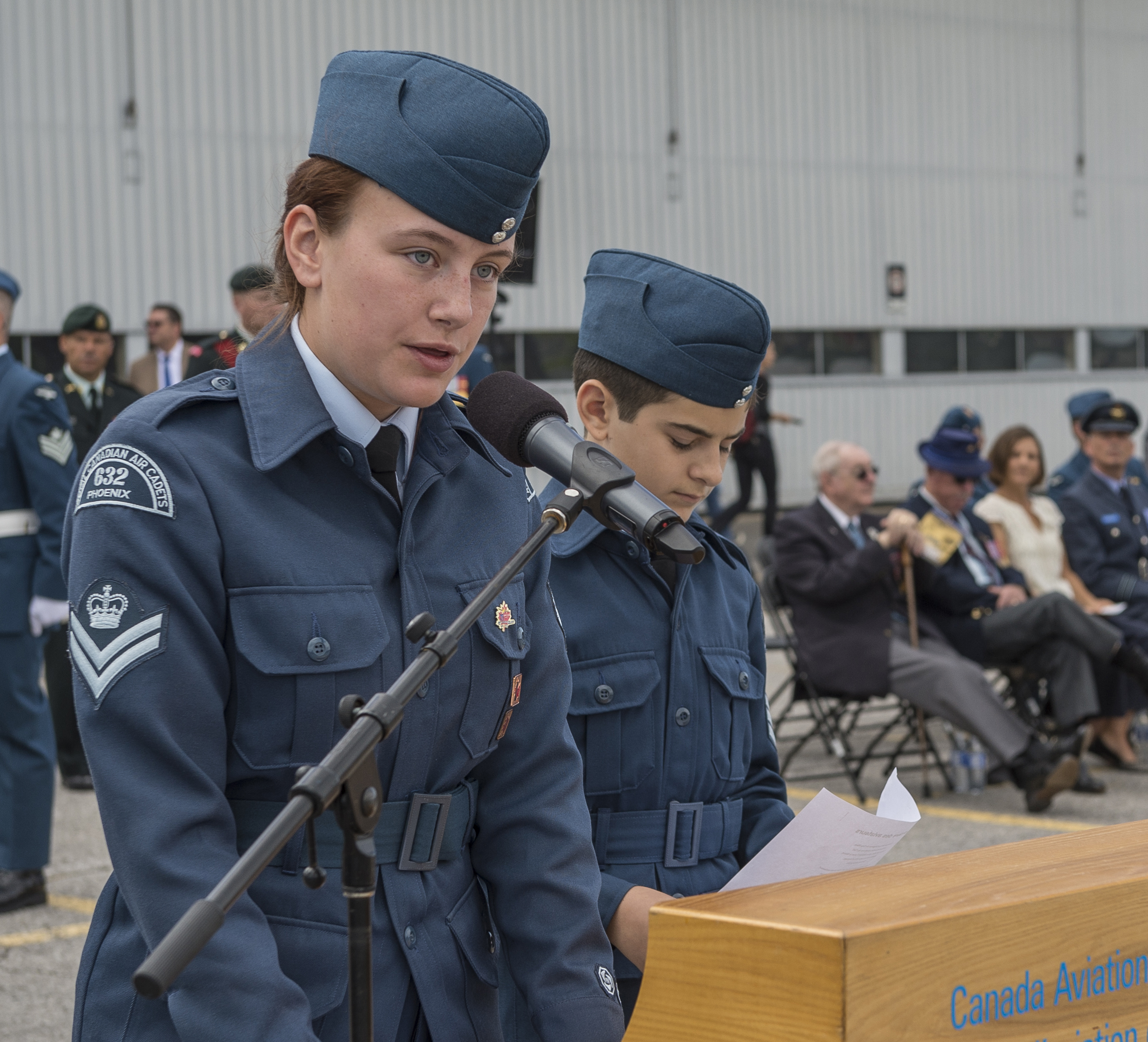 "Flight Corporal Ashtyn Ribble (left) and Sergeant Antoine Guibord, from 632 ""Phoenix"" Royal Canadian Air Cadet Squadron read the ""Airman's Prayer"" and the ""Commitment to Remember"" at the national Battle of Britain ceremony held September 18, 2016, at the Canada Aviation and Space Museum in Ottawa. PHOTO: Corporal Alana Morin, FA03-2016-0032-018"