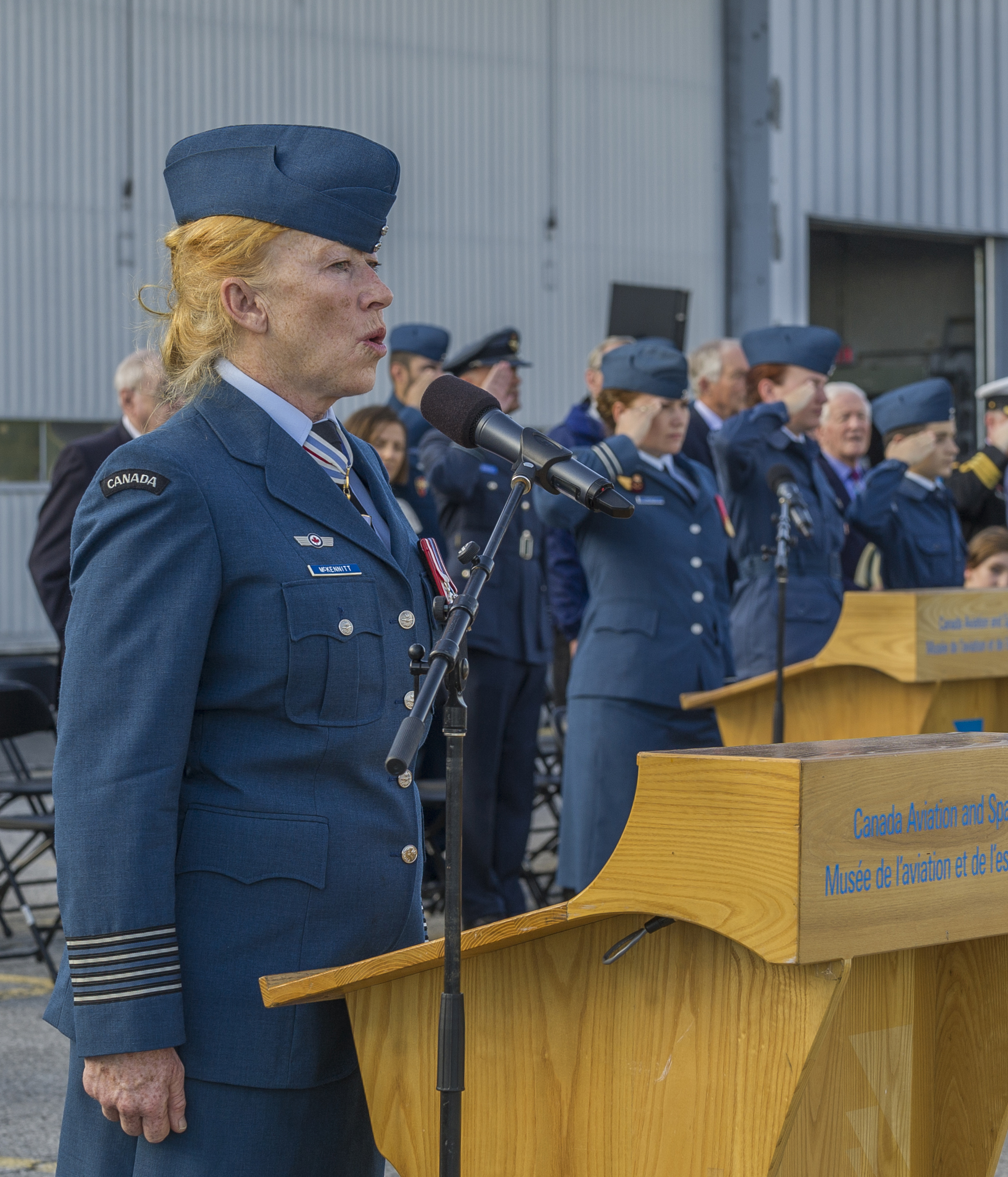 "Canadian singer-songwriter Loreena McKennitt, honorary colonel of the Royal Canadian Air Force, sings ""O Canada"" during the national Battle of Britain ceremony held September 18, 2016, at the Canada Aviation and Space Museum in Ottawa. PHOTO: Corporal Alana Morin, FA03-2016-0034"
