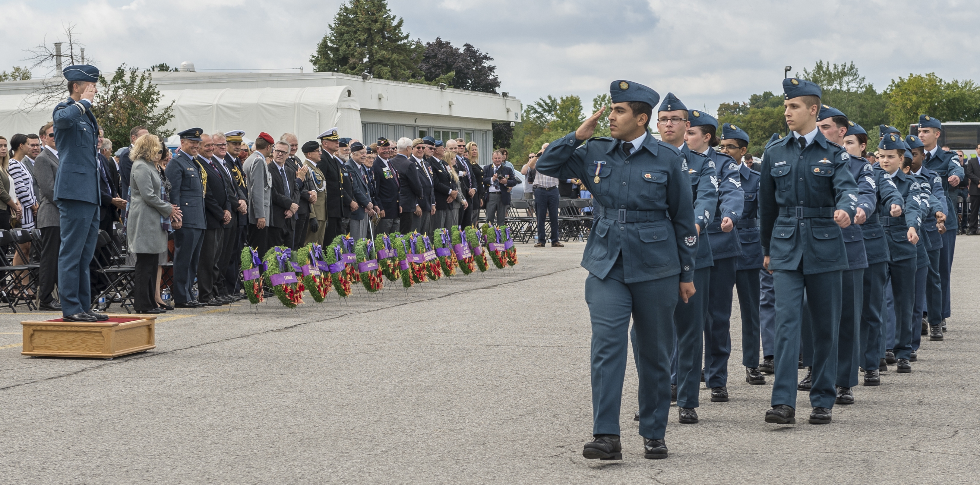Royal Canadian Air Cadets salute the deputy commander of the RCAF, Major-General Al Meinzinger, during the marchpast at the conclusion of the national Battle of Britain ceremony held September 18, 2016, at the Canada Aviation and Space Museum in Ottawa. Cadets from several area cadet squadron participated in the event. PHOTO: Corporal Alana Morin, FA03-2016-0032-038