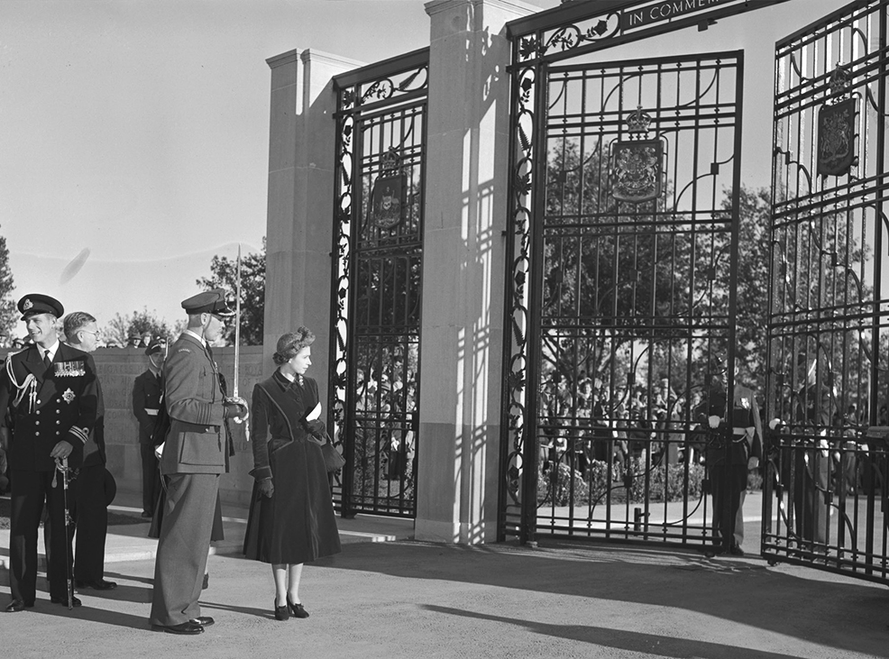 Her Royal Highness Princess Elizabeth and Group Captain G.P. Dunlop view the BCATP memorial gates at Trenton during the dedication ceremony in October 1951. PHOTO: DND Archives, PL-52822