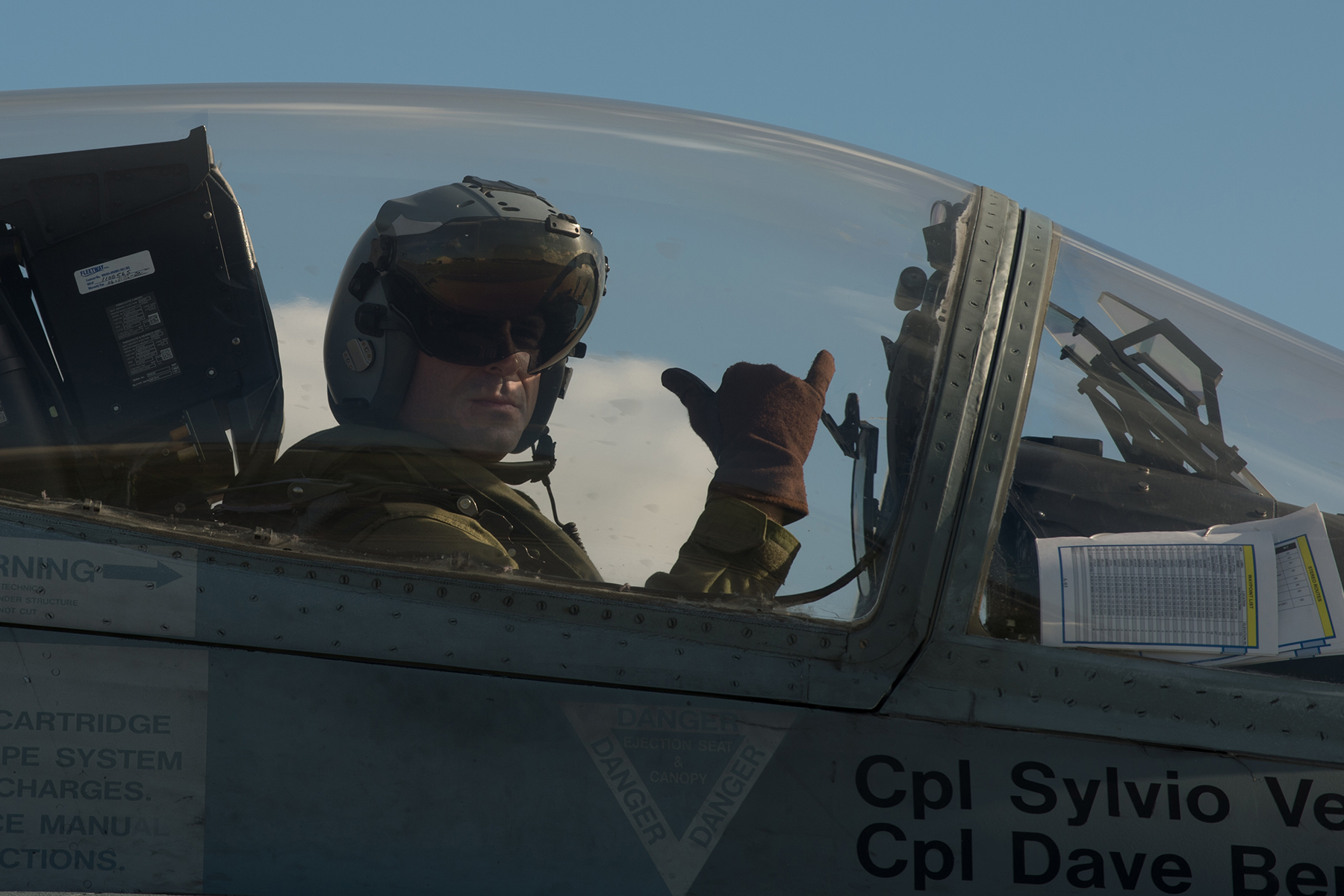 Colonel Darcy Molstad in the cockpit of a CF-188 Hornet