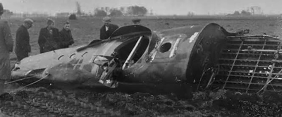 Dutch citizens look at the wrecked fuselage of Lancaster JB280 lying in a farm field near the town of Nieuw-Schoonebeek, Drenthe, Netherlands. The framework on the right of the fuselage is the floor above the bomb bay with doors gone. The faring around the hole in the centre of the fuselage section is for the H2S Radar, the antenna housing having been destroyed. Wrecks such as this would be loaded onto trucks and driven away by the Germans, to be melted down for reuse. PHOTO: Via drentheindeoorlog.nl