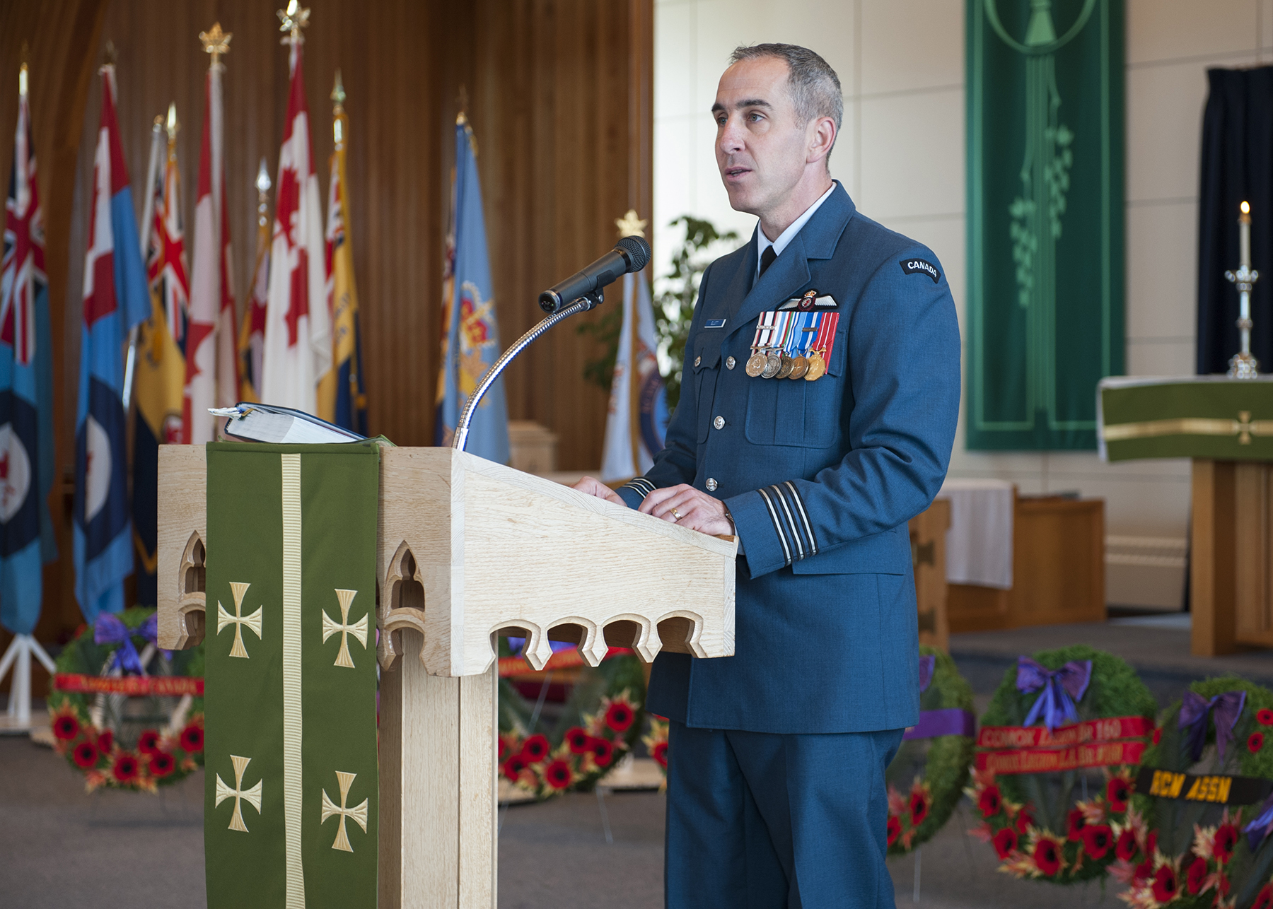 19 Wing Comox, British Columbia, acting wing commander Lieutenant-Colonel Bryn Elliott speaks to veterans, Canadian Armed Forces members and families, and guests in St. Michael and all Angels Chapel during the Battle of Britain Commemorative Service held September 18, 2016. PHOTO: Sergeant Halina Folfas, CX03-2016-0374-16