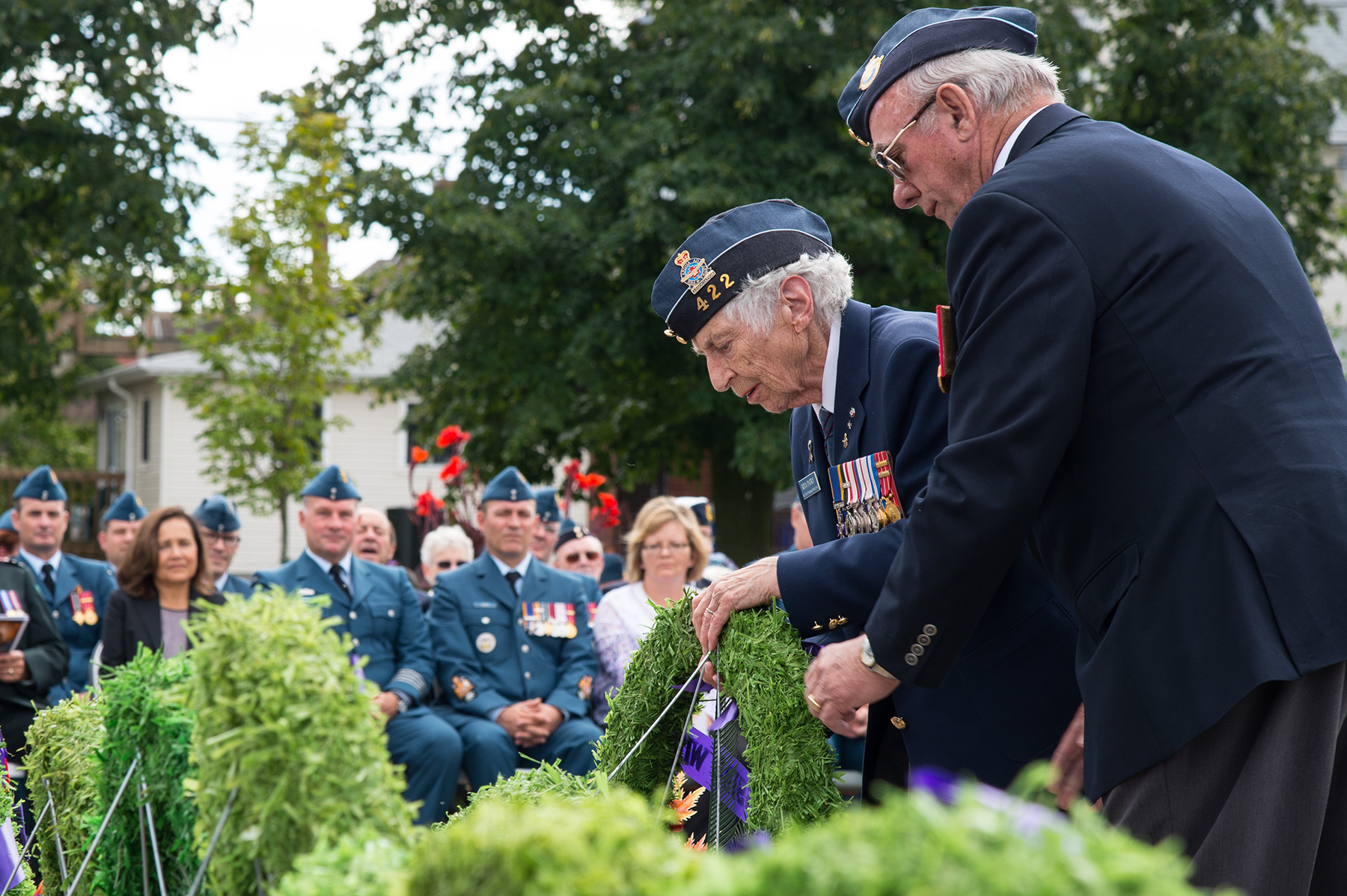 Rita Patry from 422 Squadron lays a wreath at the Memorial Monuments in North Bay, Ontario, during the 22 Wing North Bay ceremony marking the 76th anniversary of the Battle of Britain at Royal Canadian Legion Branch #23 on September 18, 2016. PHOTO: Corporal Rob Ouellette, NB01-2016-0124-020