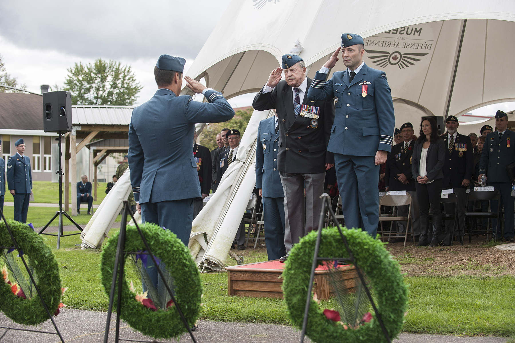 Second World War Halifax bomber pilot Jean Cauchy and Colonel Darcy Molstad, commander of Canadian Forces Base Bagotville, Quebec, return the salute during the Bagotville ceremony marking the 76th anniversary of the Battle of Britain held on September 18, 2016. PHOTO: Corporal Gary Calvé, BN07-2016-0498-005