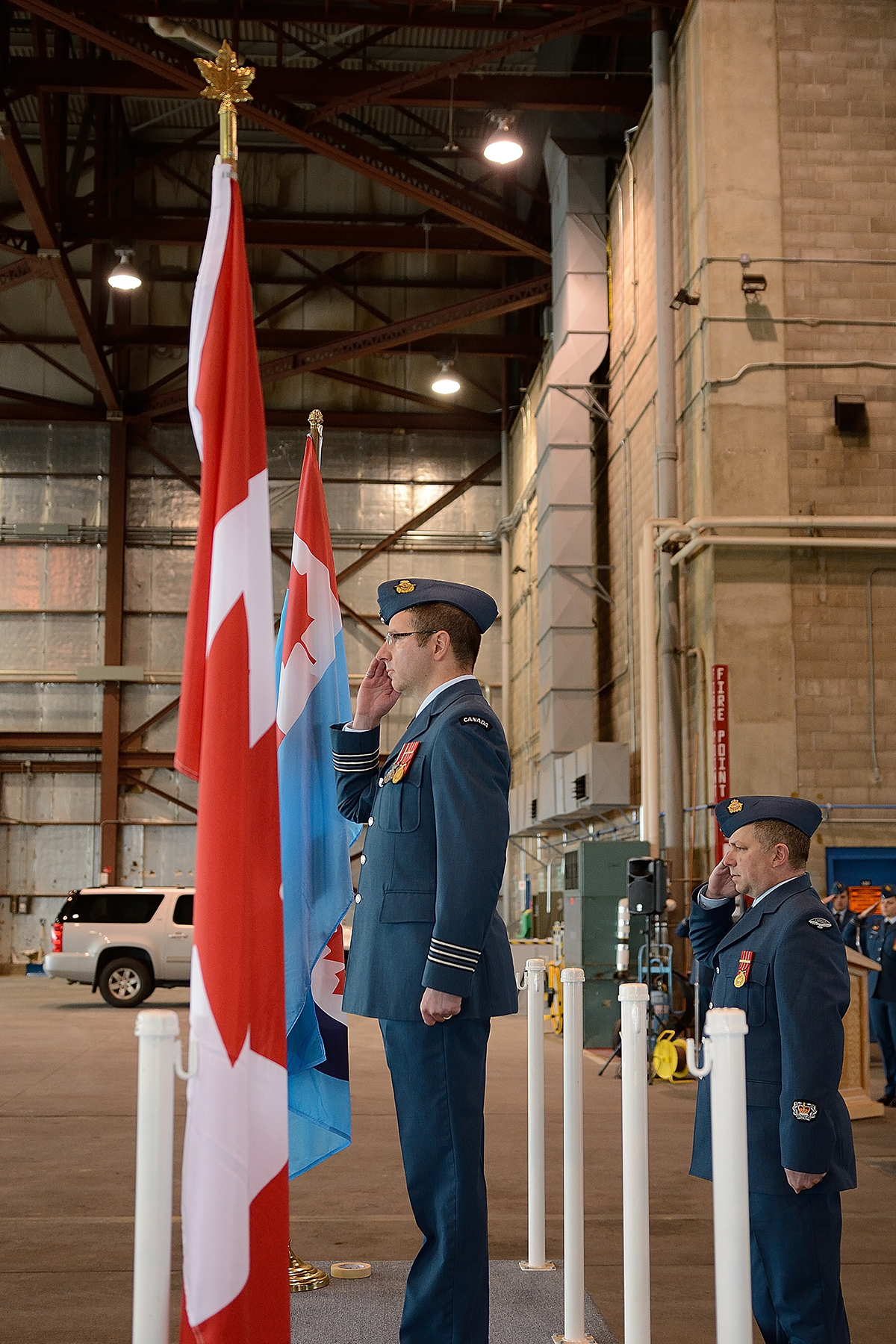 Wing commander Lieutenant-Colonel Andrew Wedgwood, and wing chief warrant officer Master Warrant Officer Richard Coltart salute during the parade held on September 18, 2016,  at 5 Wing Goose Bay, Newfoundland and Labrador, to mark the 76th anniversary of the Battle of Britain. PHOTO: Master Corporal Krista Blizzard, GB 2016-09-012