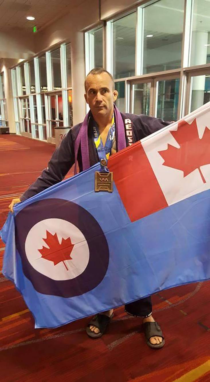 Sergeant Bernie Antle displays the Royal Canadian Air Force flag on August 27, 2016, during the World Master Jiu-Jitsu IBJJF Championship held in Las Vegas, Nevada, where he earned a Bronze. PHOTO: Courtesy of Sergeant Bernie Antle