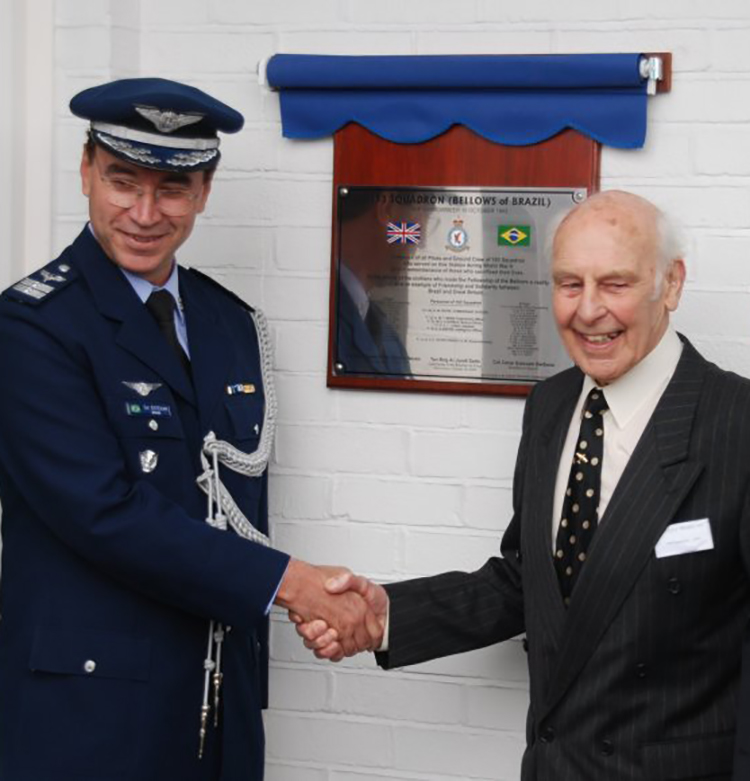 Brazilian Air Attaché Colonel Cesar Estevam Barbosa and Squadron Leader (retired) Percy Beake shake hands at RAF Harrowbeer on October 16, 2009, after the unveiling of a plaque commemorating the October 16, 1943, gift of nine Hawker Typhoons to No. 193 Squadron, and honouring the service and sacrifice of the Anglo-Brazilians who fought for England during the Second World War. Mr. Beake attended both the 1943 and the 2009 ceremonies. PHOTO: RAF Harrowbeer  [http://www.rafharrowbeer.co.uk/old_news.htm (available only in English)]
