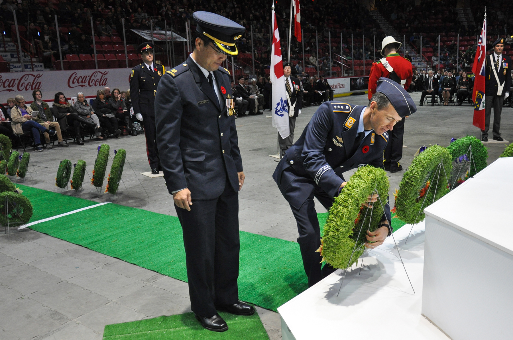 At Mosaic Place in Moose Jaw, Saskatchewan, Major Yoo Hean Liew (left), of the Royal Singapore Air Force, and Captain Alexej Nachtigal, of the German Air Force, lay a wreath on behalf of foreign service members during the November 11, 2016, Remembrance Day ceremony. PHOTO: Lieutenant Jennifer Halliwell