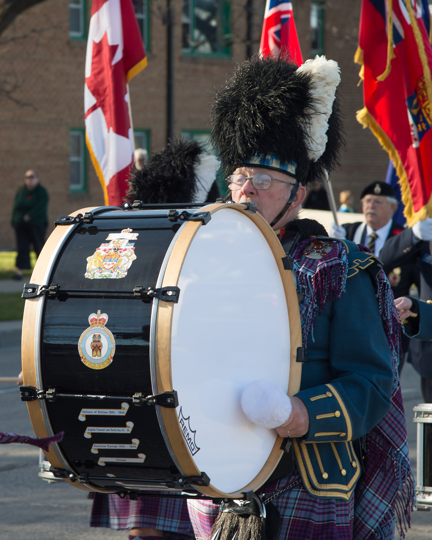 "402 ""City of Winnipeg"" Squadron drummer Bob Vass marches down Portage Avenue after the Remembrance Day ceremony held at Bruce Park in Winnipeg, Manitoba, on November 11, 2016. PHOTO: Corporal Paul Shapka"