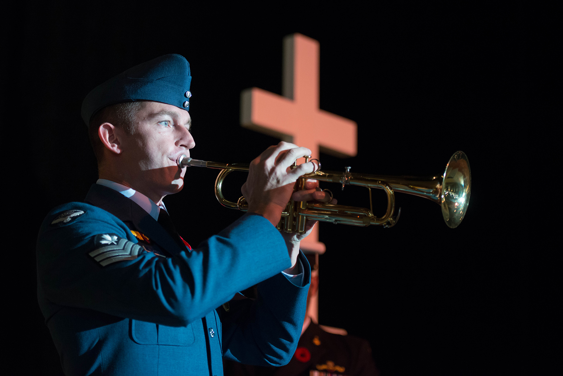"Sergeant Marleau Belanger, of the Royal Canadian Air Force Band, sounds ""The Last Post"" during the Joint Veterans' Association Remembrance Day Service attended by members of 17 Wing Winnipeg, Manitoba, and held at the RBC Convention Centre in Winnipeg on November 11, 2016. The service commemorated the 100th anniversary of the Battle of the Somme. PHOTO: Sergeant Daren Kraus"