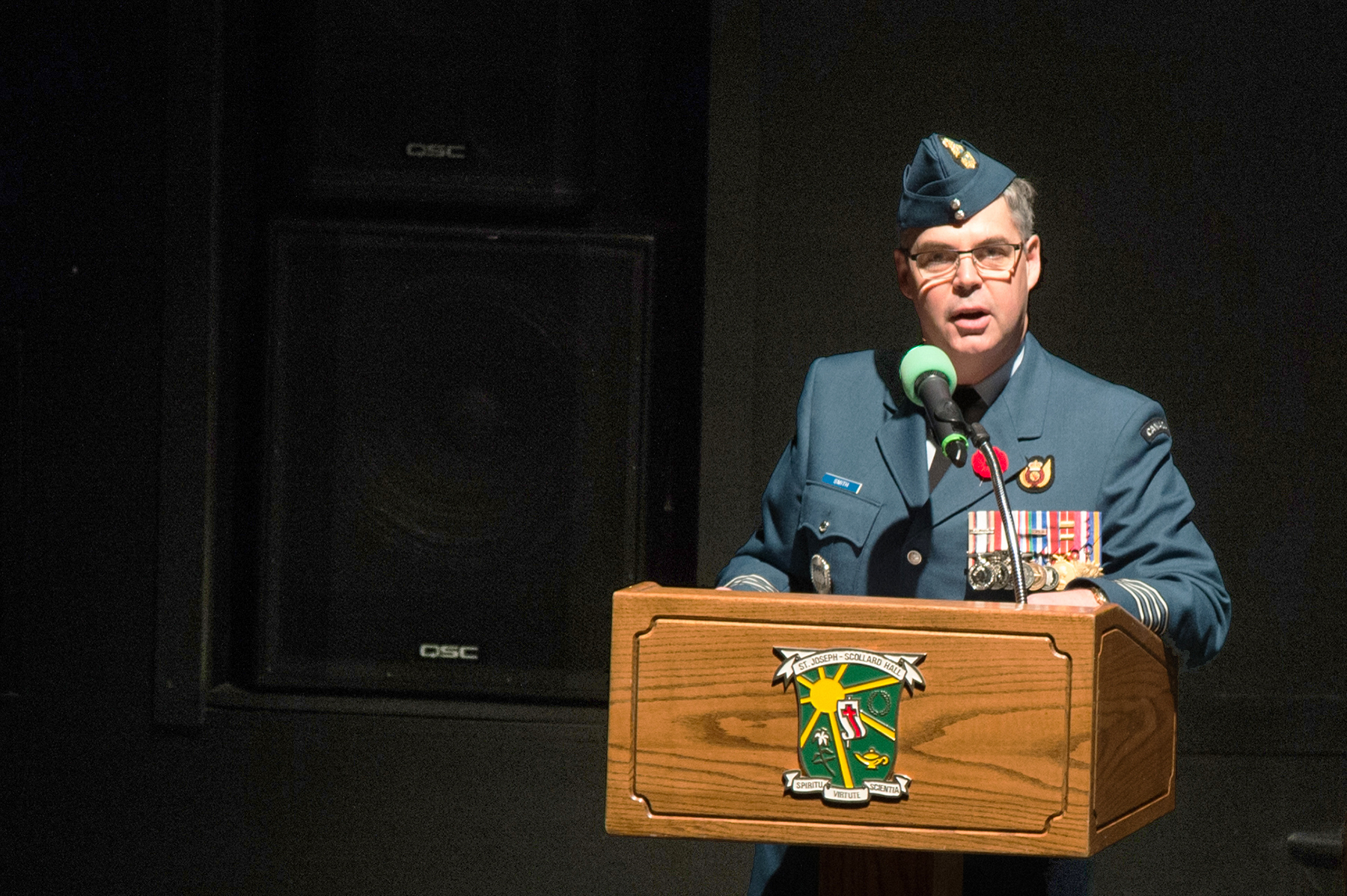Colonel Henrik Smith, commander of 22 Wing North Bay, Ontario, speaks to the students of St. Joseph Scollard Hall high school in North Bay during the school's Remembrance Day assembly on November 10, 2016. All Canadian Armed Forces members are encouraged to give presentations at local schools or other community organizations under the Veterans' Week Speakers Program. PHOTO: Corporal Rob Ouellette