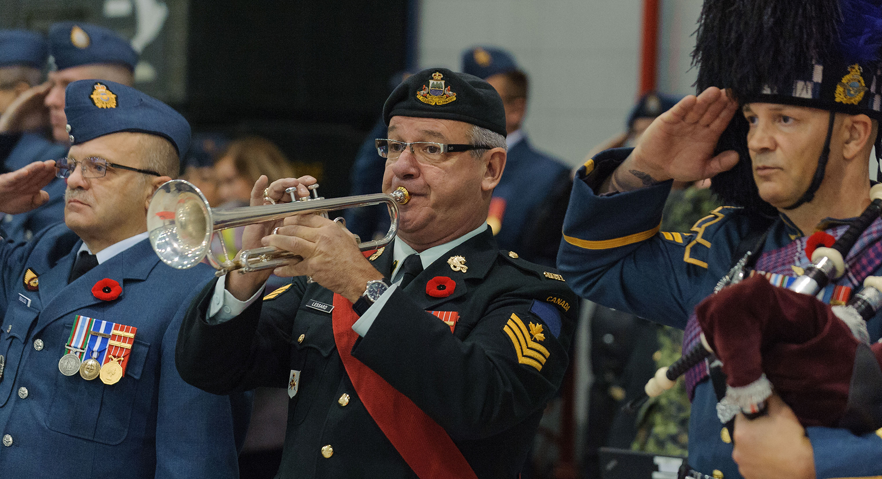 Sergeant André Lessard, Saguenay Regiment trumpet player, plays during the Remembrance Day ceremony held at Canadian Forces Base Bagotville, in Québec, on November 11, 2016. PHOTO: Master Corporal Louis Brunet