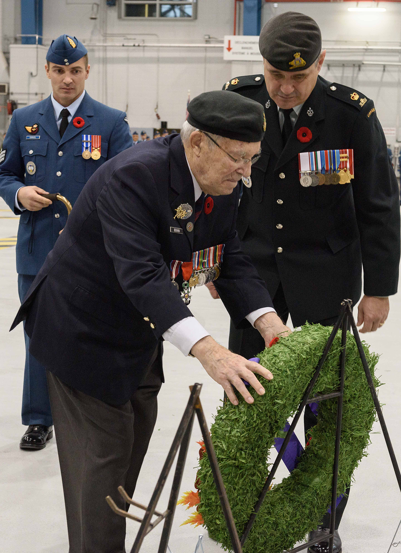 Reviewing officer Lieutenant-Colonel (retired) Adrien Boivin lays a wreath during the Remembrance Day ceremony held at Canadian Forces Base Bagotville, in Québec, on November 11, 2016. PHOTO: Master Corporal Louis Brunet