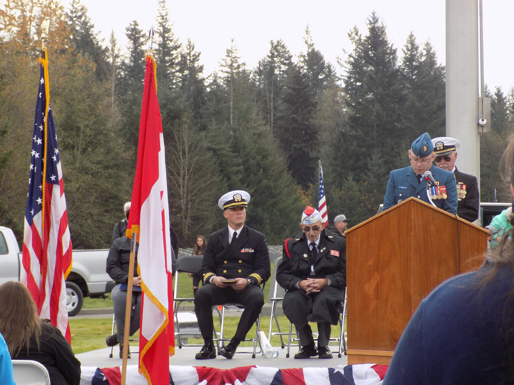 "The Royal Canadian Air Force's Warrant Officer Rick Martin, unit warrant officer of the Canadian Detachment serving at Joint Base Lewis-McChord, reads ""In Flanders Fields"" at the Veteran's Day ceremony held at Tahoma National Cemetery in Washington State on November 11, 2016. PHOTO: DND"