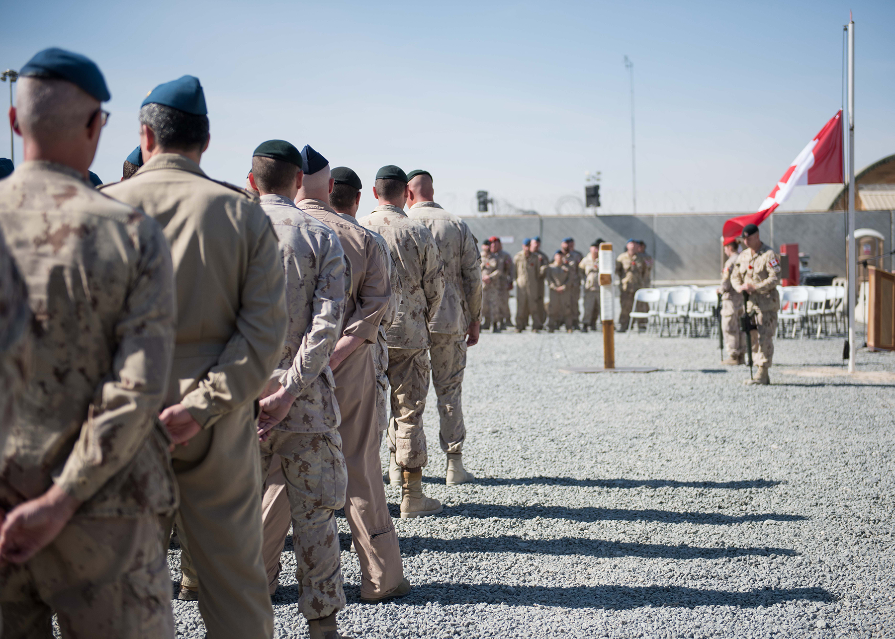 Men and women of Joint Task Force - Iraq observe Remembrance Day at a parade in Camp Canada on November 11, 2016. PHOTO: Operation Impact
