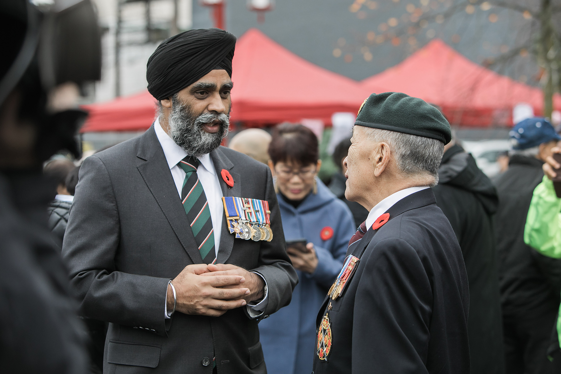 Harjit Sajjan, Minister of National Defence, speaks to a veteran at the Remembrance Day ceremony held in Vancouver, British Columbia's Chinatown on November 11, 2016. PHOTO: Bombardier Albert Law