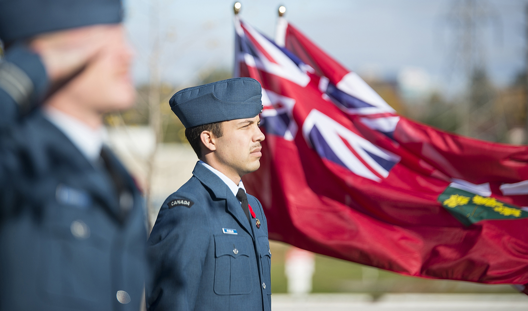 During the Remembrance Day ceremony held at Seneca College in Toronto, Ontario, on November 11, 2016, Captain Othello Fugulin stands at attention while parade commander Captain John Campbell salutes. Both are students in the Canadian Armed Forces Air Environmental Affiliated Degree program. PHOTO: Tai Nguyen, Seneca College