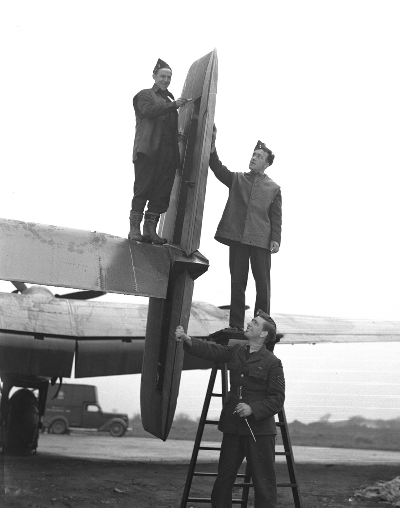 "Groundcrew of 428 ""Ghost"" Squadron work on one of ""their"" aircraft in an undated photograph. PHOTO: DND Archives, PL-28665"