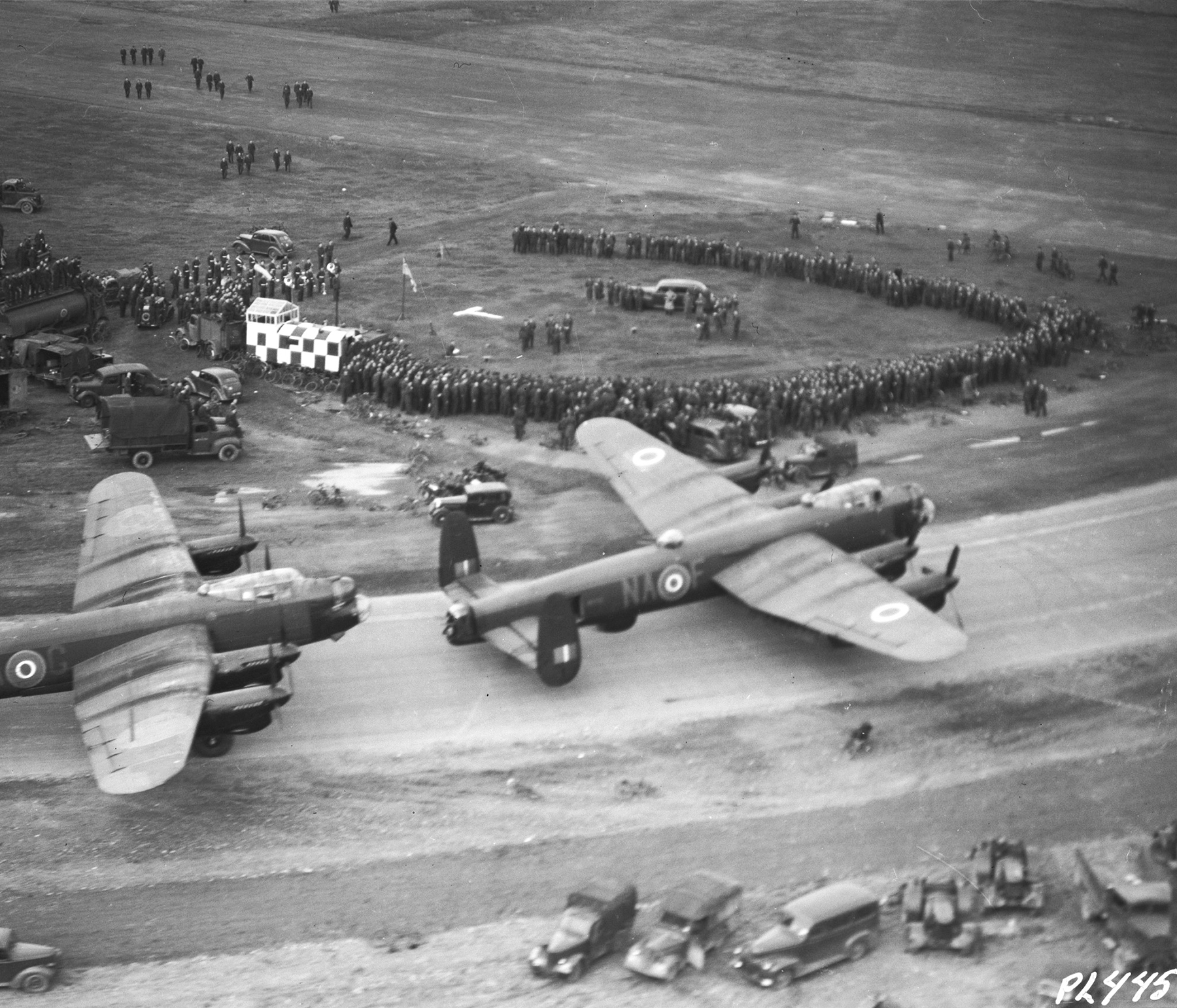 "On May 31, 1945, two Lancaster bombers of 428 ""Ghost"" Squadron and 419 ""Moose"" Squadron taxi on the flight line in Yorkshire, England. PHOTO: DND Archives, PL-44557"