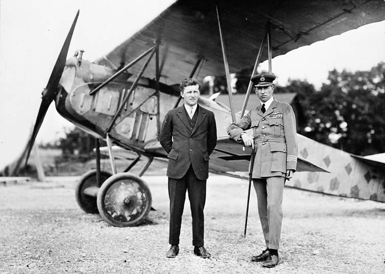 A post-Second World War photo of Billy Bishop (left) and William Barker standing in front of a Fokker D.VII. Wing Commander Barker's left arm hangs limply at his side because his elbow had been irreparably shattered by enemy gunfire in the combat engagement for which he was awarded the Victoria Cross. PHOTO: DND Archives, RE68-5450