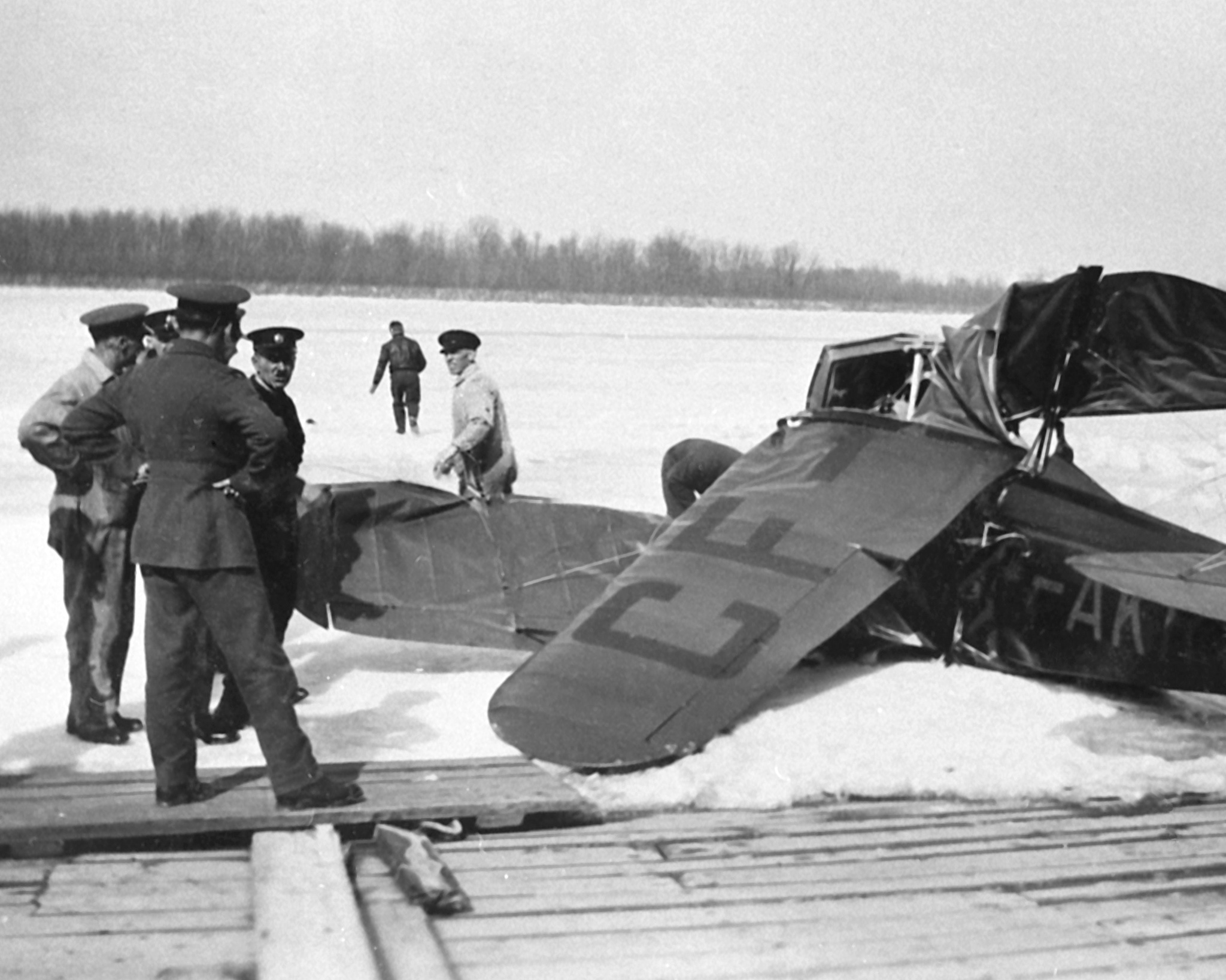 The wreckage of Fairchild KR-21, CF-AKR, on the ice of the Ottawa River on March 12, 1930. Wing Commander (retired) William Barker died in the crash. PHOTO: DND Archives, RE74-166