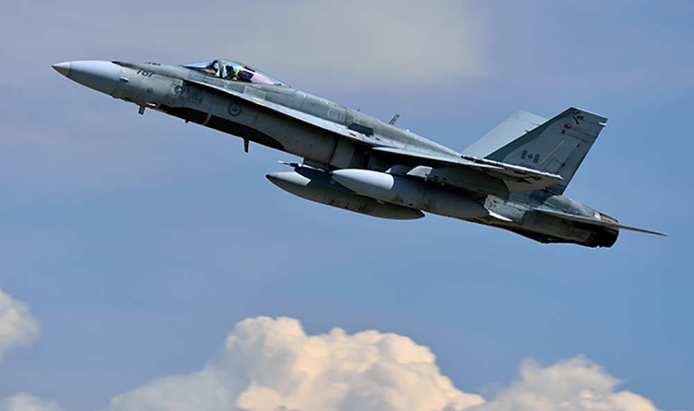An RCAF CF-188 Hornet fighter takes to the sky.