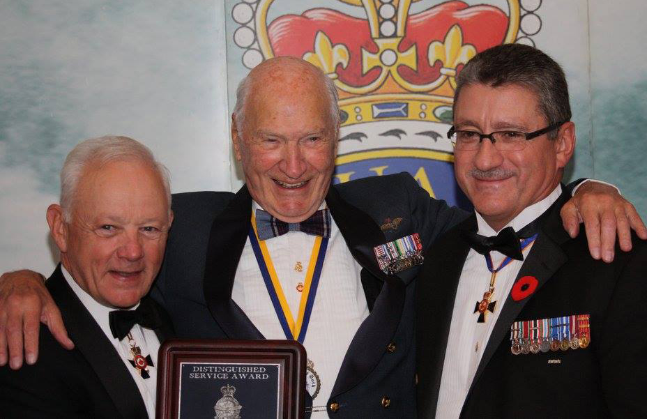 Lieutenant-Colonel (retired) Syd Burrows is presented with the RCAF Association's Distinguished Service Award by Lieutenant-General (retired) Lloyd Campbell, the outgoing honorary president of the Association, and Lieutenant-General (retired) André Deschamps, the incoming honorary president. Lieutenant-Generals Campbell and Deschamps are both former commanders of Canada's Air Force. PHOTO: Lieutenant-Colonel (retired) Dean Black, RCAFA