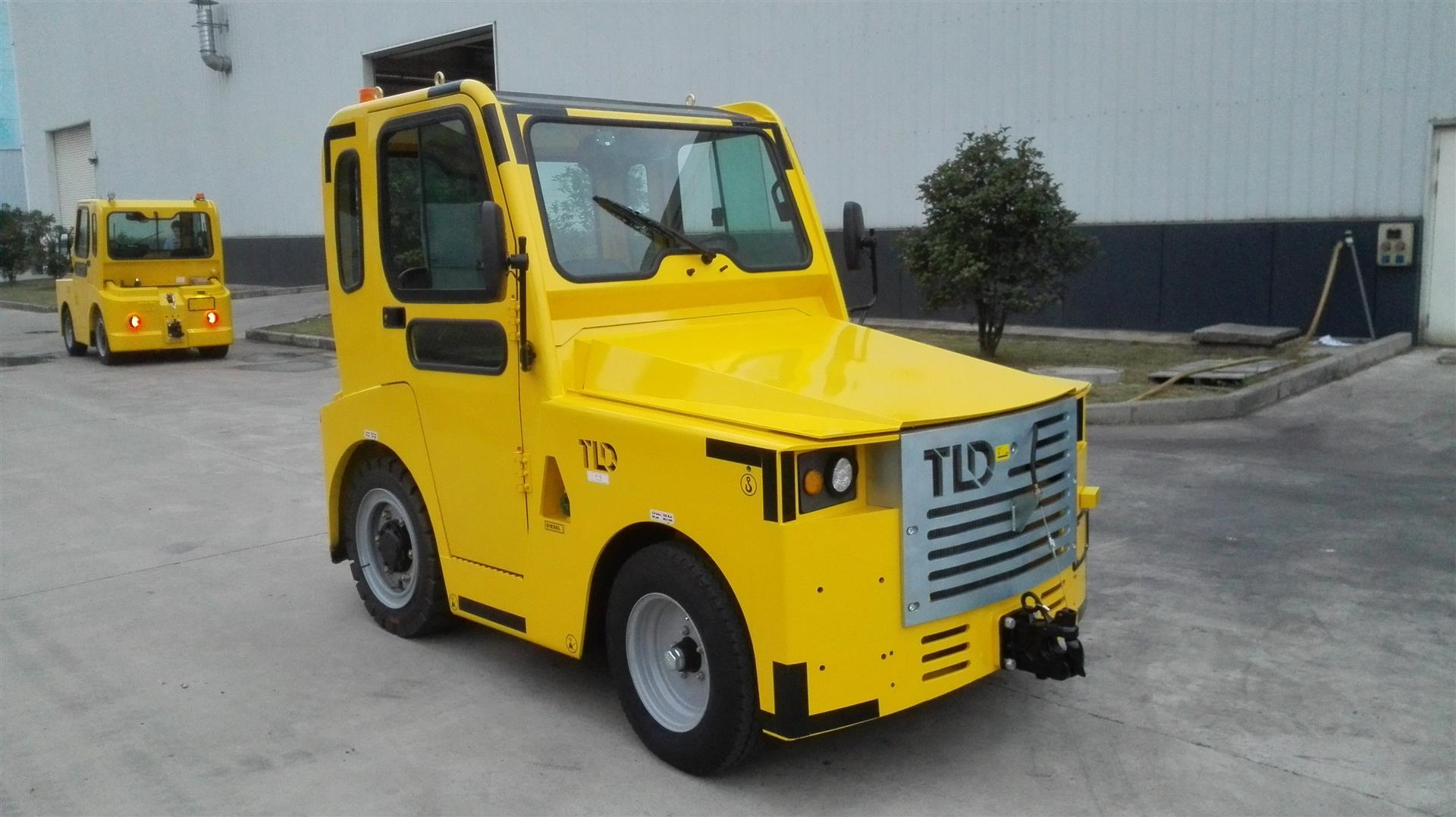 A small yellow vehicle with an enclosed cab.