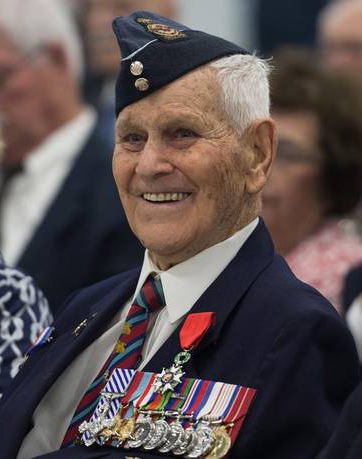 Lieutenant-Colonel (retired) Russell Hubley, DFC, CD, wears the red-ribboned Légion d'honneur (Knight) that French diplomat Vincent Hommeril, from Normandy, presented to him on June 20, 2014, at 12 Wing Shearwater, Nova Scotia. The RCAF veteran was awarded the medal in recognition of the bombing runs he and his Lancaster bomber crewmates made over Normandy on D-Day, June 6, 1944. PHOTO: The Chronicle Herald