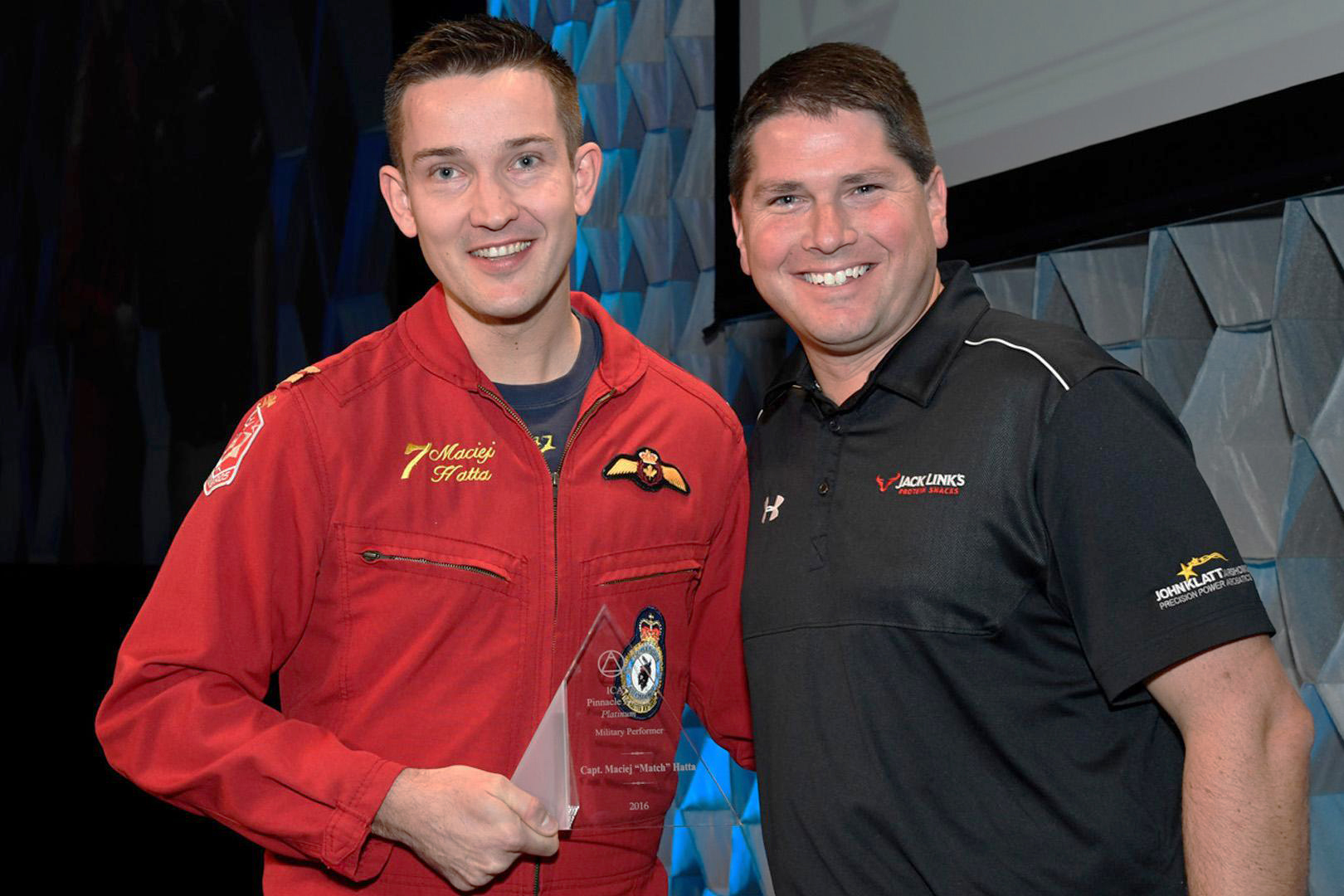 "Captain Maciej ""Match"" Hatta (left) pauses for a photodisplays his 2016 International Council of Air Shows (ICAS) ""Platinum"" Pinnacle Award after the awards ceremony. PHOTO: ICAS"