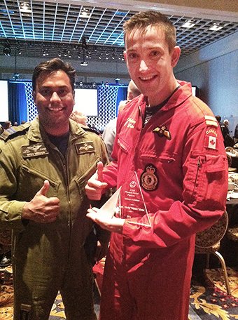 "Captain Maciej ""Match"" Hatta (right) and Captain Gregory ""Coco"" Mendes participate in the 2016 International Council of Air Shows (ICAS); the 431 Air Demonstration Squadron (Snowbirds) badge."