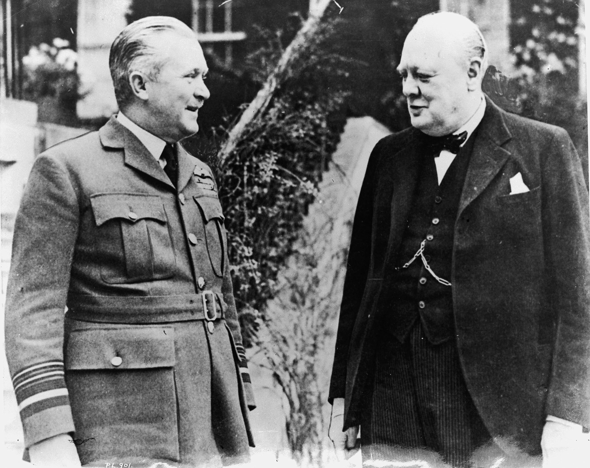 "A meeting of giants: Honorary Air Marshal William Avery ""Billy"" Bishop chats with British Prime Minister Winston Churchill in England in 1940. PHOTO: DND Archives, PL-901"