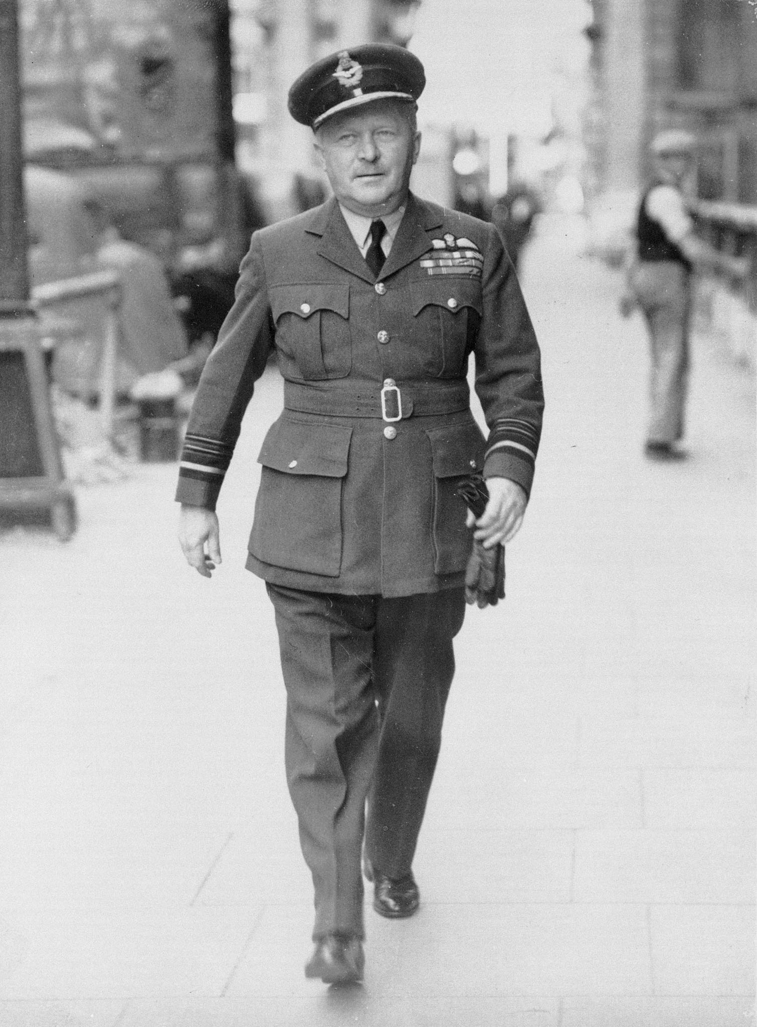 Air Marshal William Avery Bishop strides purposefully down an unknown street on December 4, 1940. PHOTO: DND Archives, PL-999