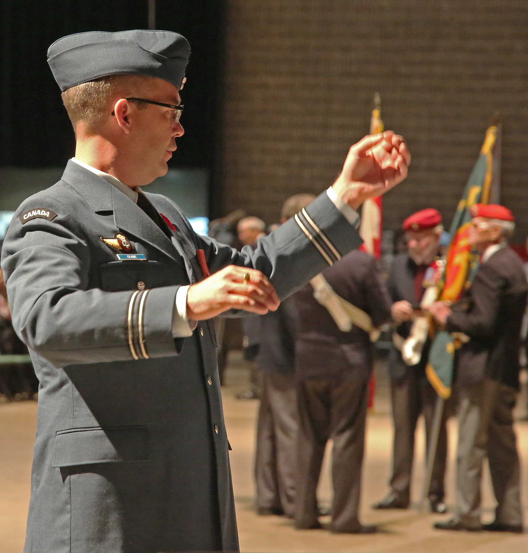 Captain Matthew Clark, commanding officer and director of music for the Royal Canadian Air Force Band, warms up the band before a November 11, 2016, Remembrance Day ceremony. PHOTO: Dona Neves