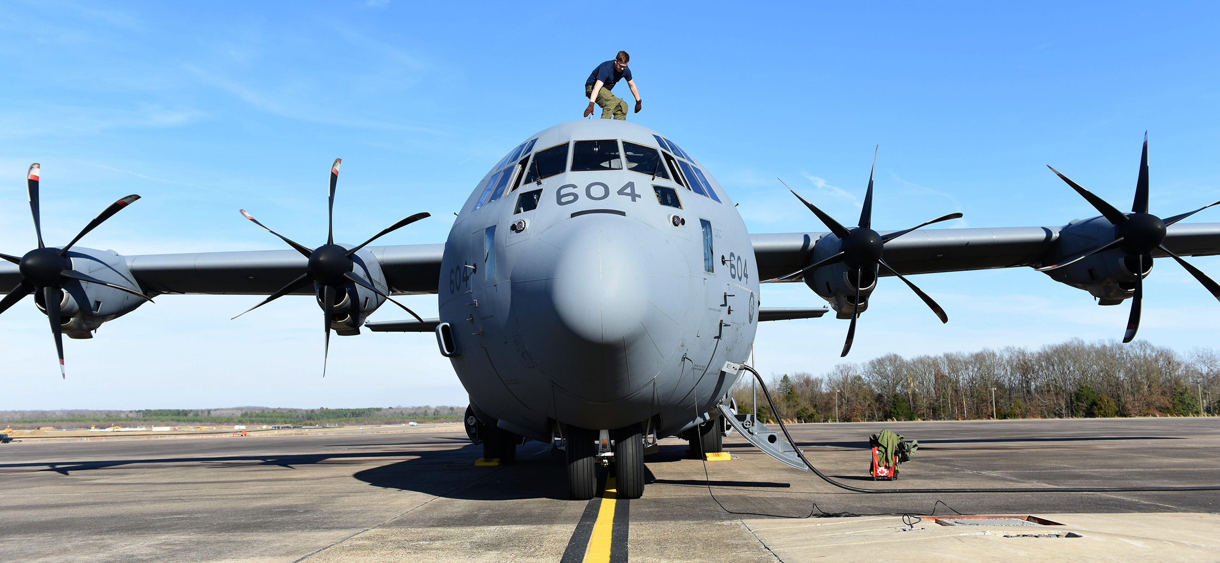 Corporal Julien Simard, a loadmaster from 436 Transport Squadron, performs his pre-flight checks on a CC-130J Hercules on February 10, 2017, at Little Rock Air Force Base, Arkansas, during Exercise Green Flag Little Rock. PHOTO:  Senior Airman Mercedes Taylor, USAF