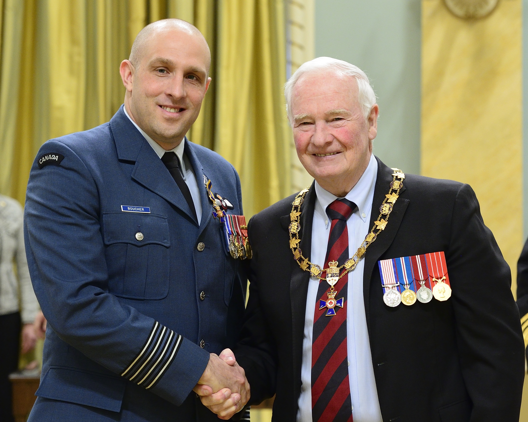Governor General and Commander-in-Chief of Canada David Johnston presents the Order of Military Merit to Lieutenant-Colonel Jeannot Emmanuel Boucher, OMM, MSM, CD, from the 