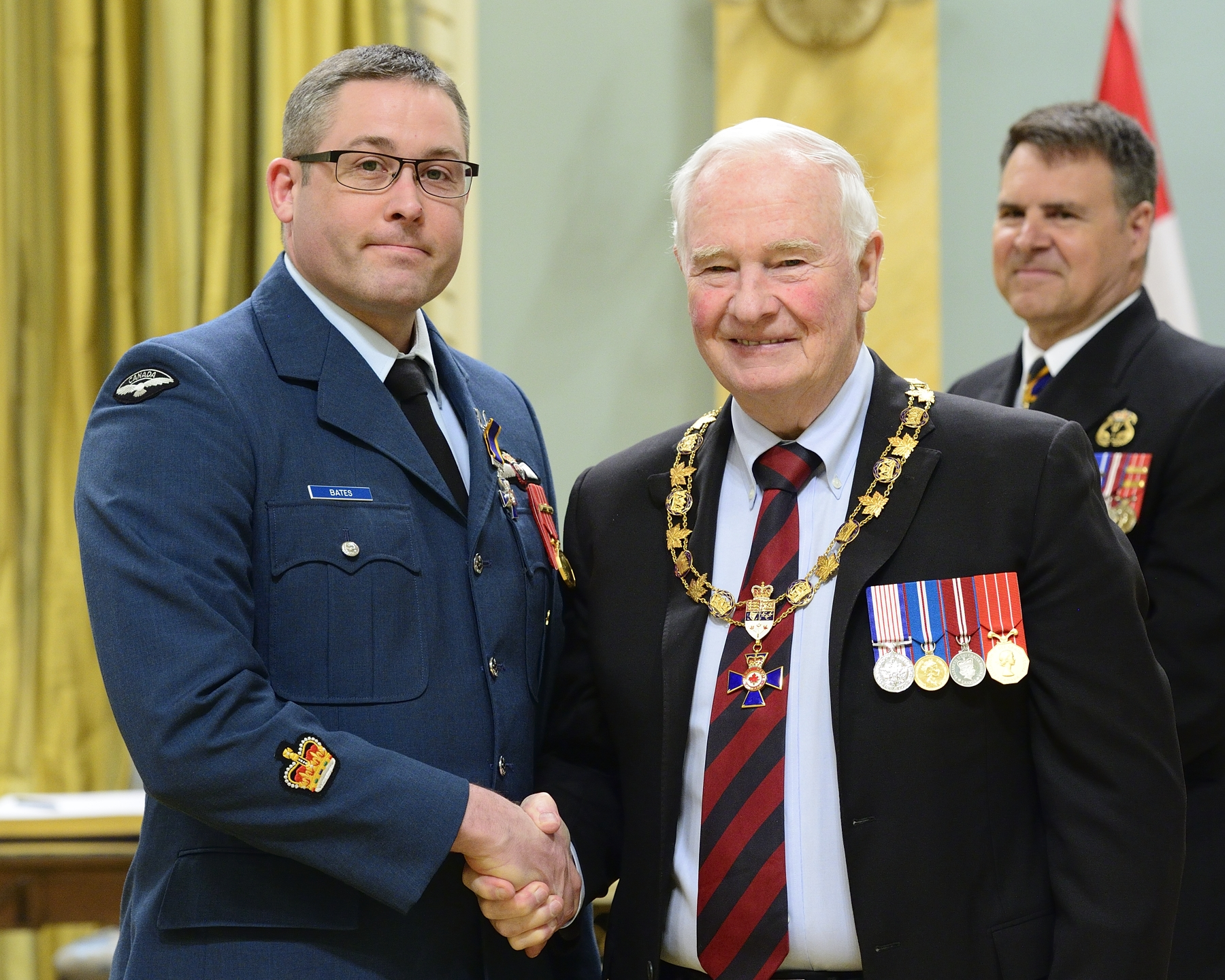 Governor General and Commander-in-Chief of Canada David Johnston presents the Order of Military Merit to Sergeant Stephen Claude Joseph Bates, MMM, CD, from  