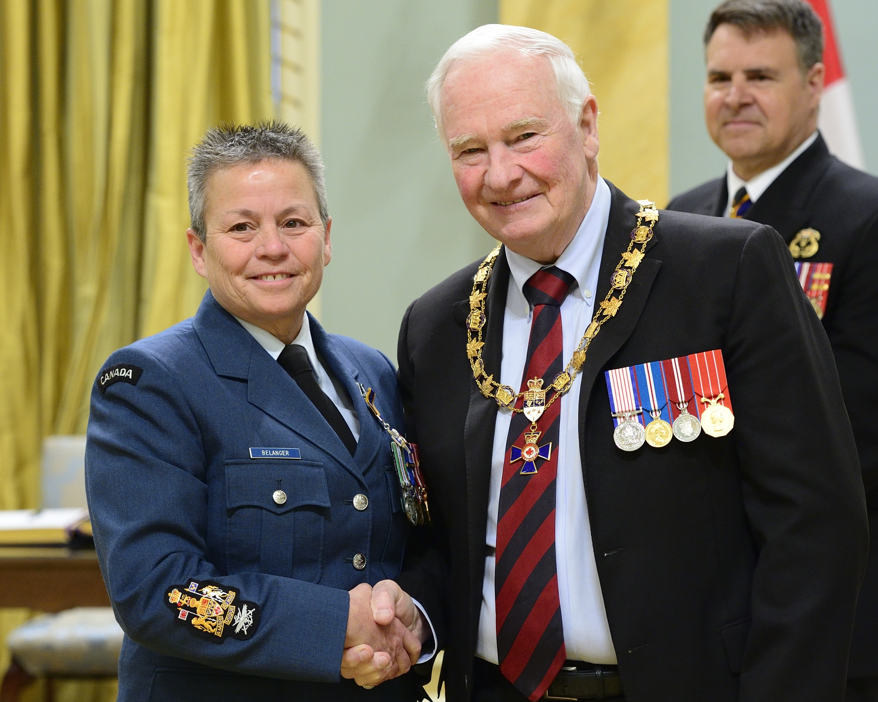 Governor General and Commander-in-Chief of Canada David Johnston presents the Order of Military Merit to Chief Warrant Officer Necole Elizabeth Belanger, MMM, CD 