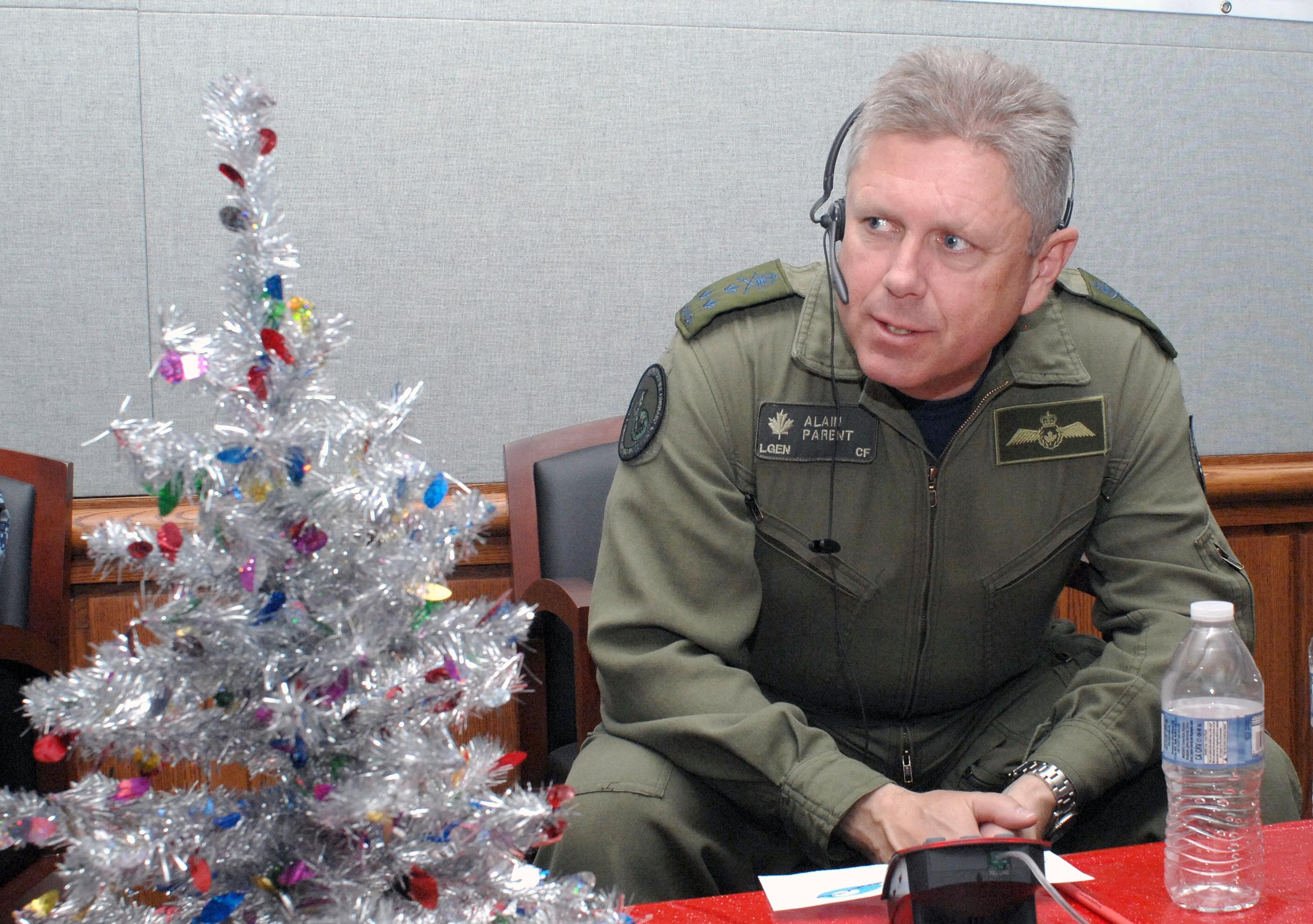 Lieutenant-General Alain Parent, then-deputy commander of NORAD, takes calls at the NORAD Tracks Santa operations center at NORAD Headquarters in Colorado on December 24, 2012. PHOTO: Technical Sergeant Thomas J. Doscher, USAF