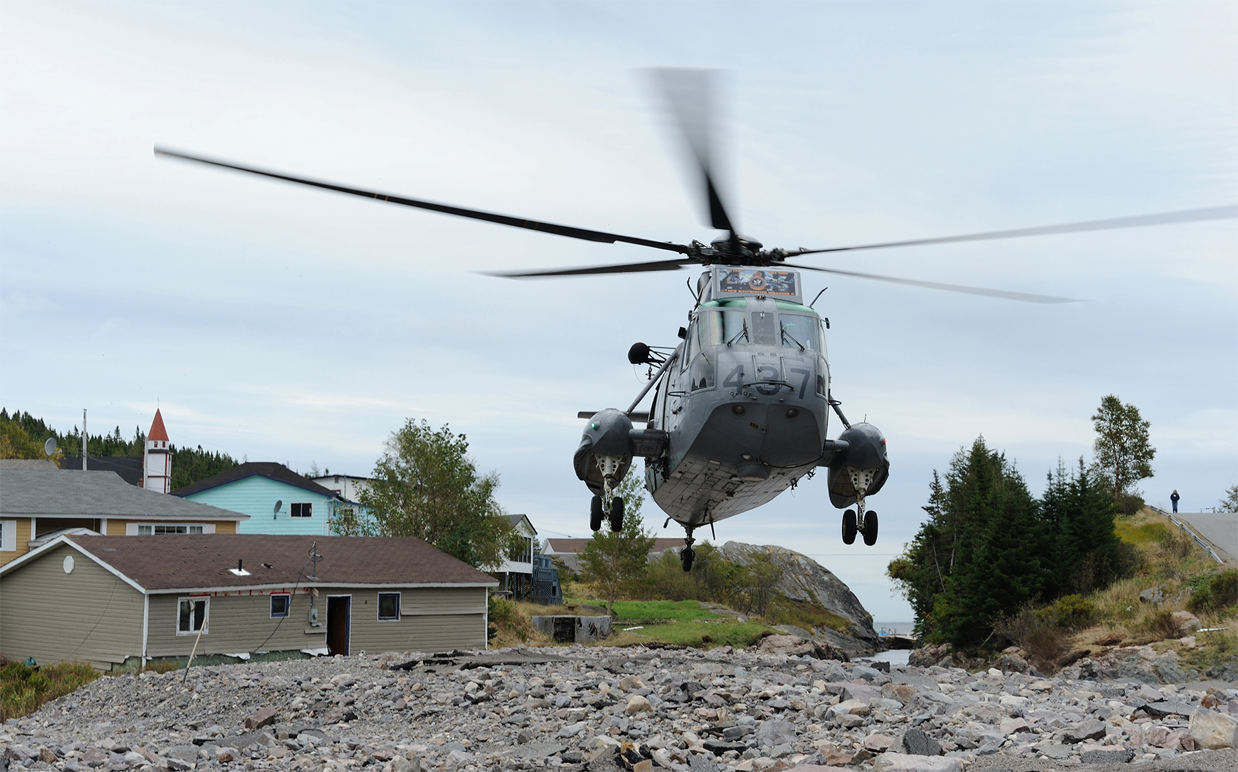A CH-124 Sea King from 423 Maritime Helicopter Squadron, Shearwater, Nova Scotia, takes off from a river bed in the small community of Trouty, Newfoundland and Labrador. The squadron was supporting relief efforts in the province following Hurricane Igor in September 2010. PHOTO: Master Corporal Angela Abbey, IS2010-1015-02