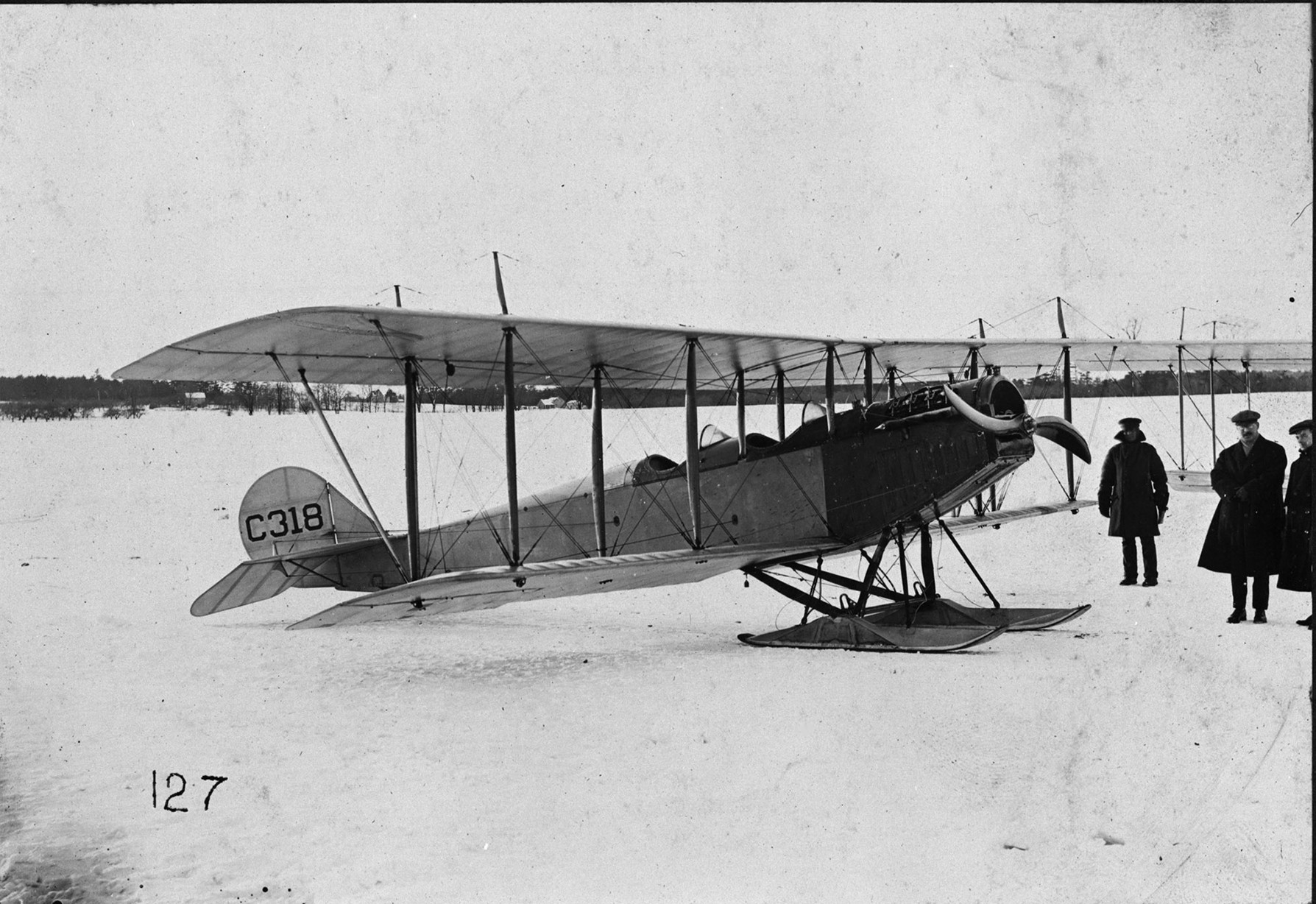 "A JN-4 ""Canuck"" equipped with snow skids. While most of the RFCC's training group relocated to Texas to continue training in a warmer environment, those left behind pioneered flying in winter conditions. PHOTO: DND Archives, RE-19150"