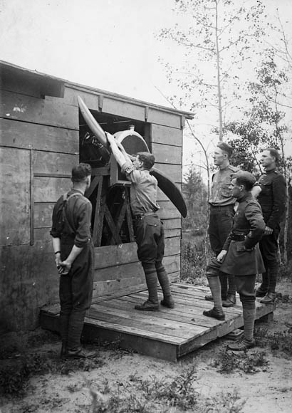 In a 1917 photograph, Royal Flying Corps Canada cadets learn how to swing-start an aircraft propeller at Camp Borden, Ontario. PHOTO: LAC MIKAN 3404143