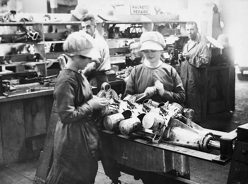 "In the engine repair section at Camp Mohawk, a Royal Flying Corps Canada facility in Deseronto, Ontario, women overhaul a Curtiss OX-5, the engine that powered the Curtiss JN-4 ""Canuck"" trainer aircraft. PHOTO: DND Archives, PA-022784"
