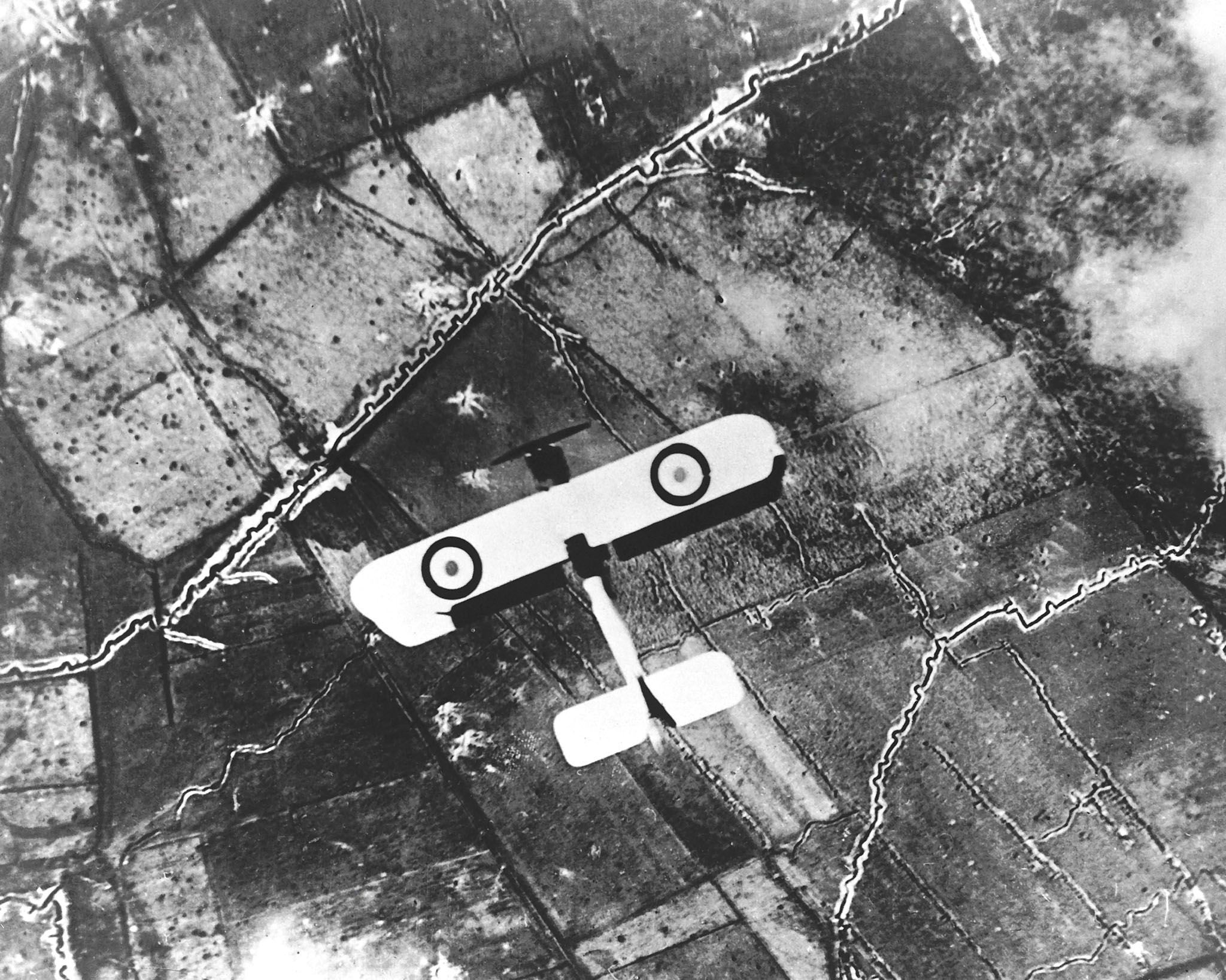 In this undated photo, a British B.E. 2 flies low over the trenches in France. PHOTO: DND Archives, PMR74-661